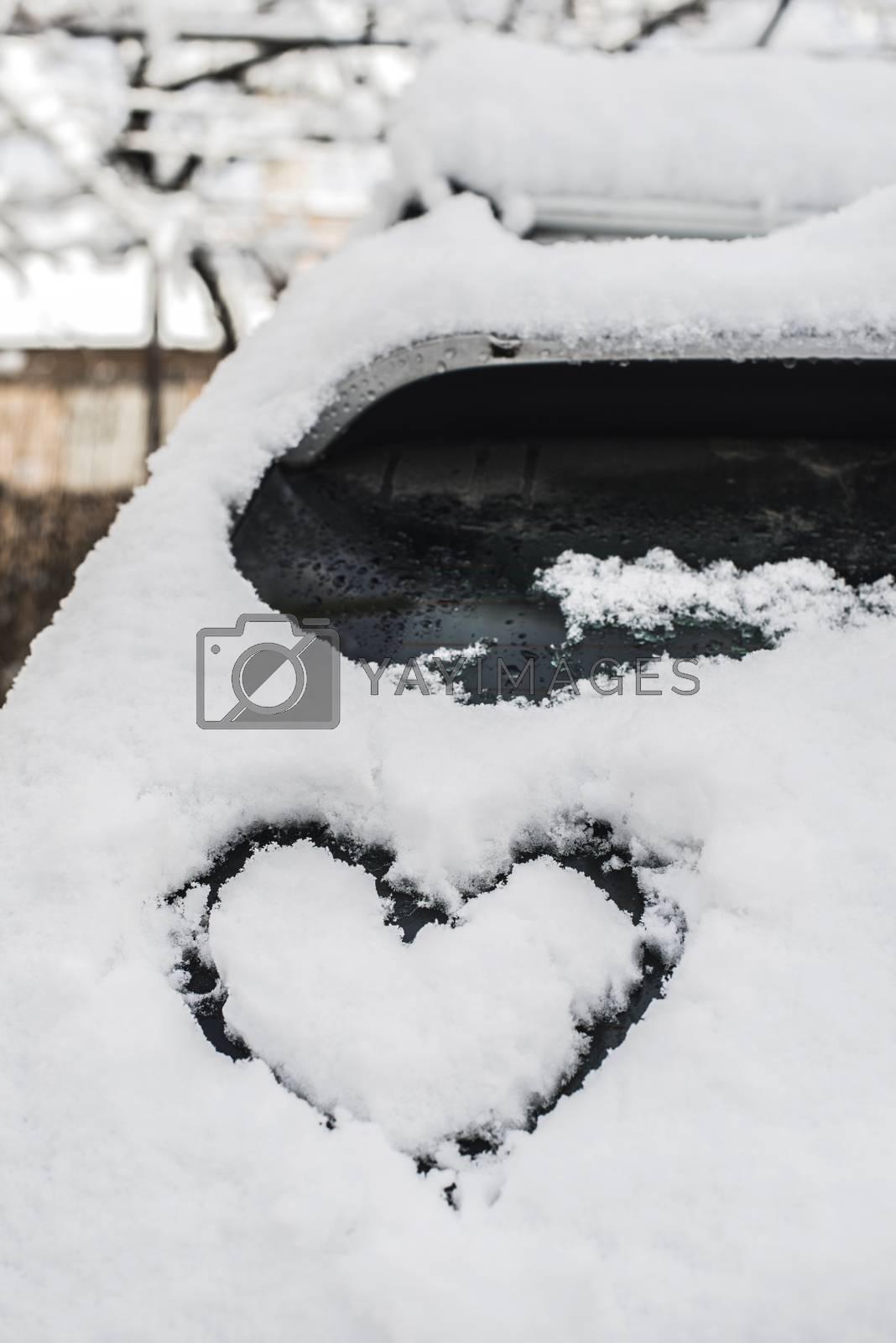 Snow heart shape on car by Georgiev