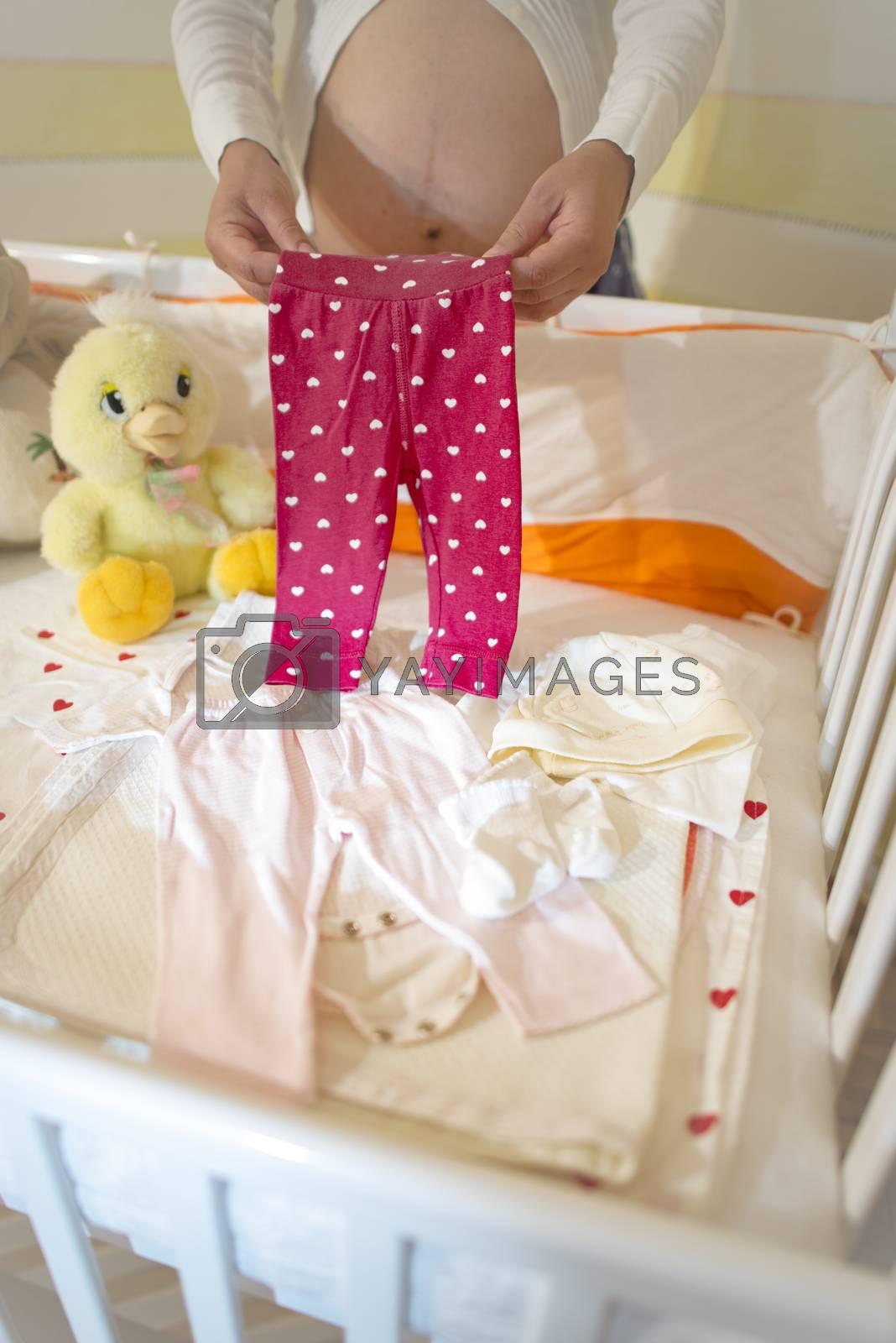 Pregnant women in a baby room. by deyan_georgiev