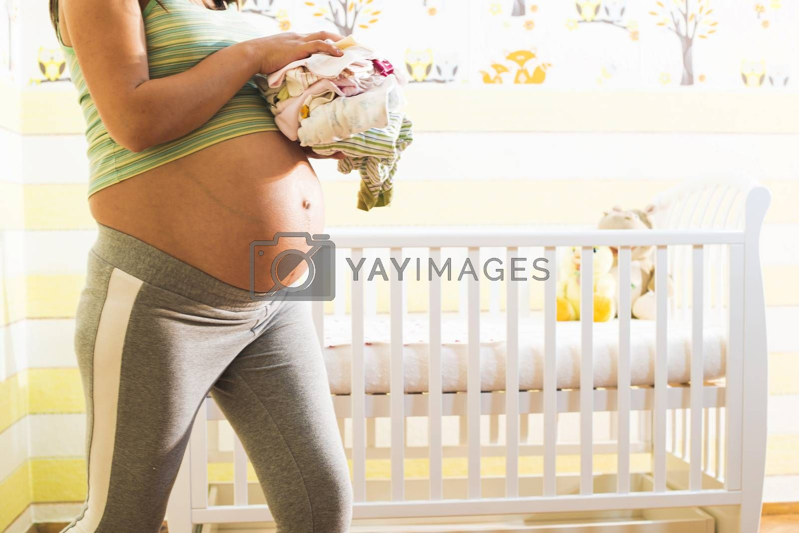 Pregnant women in a baby room. by deyan_georgiev