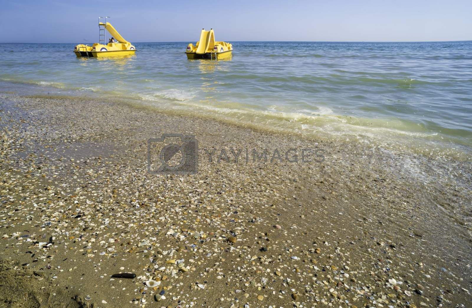 Yellow lifeboat on the beach. Italian beach