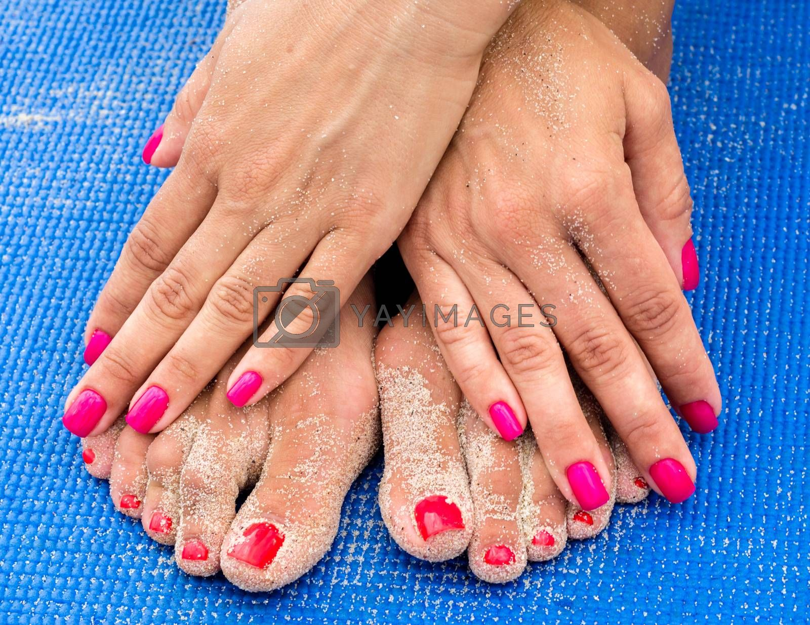 female hands with red manicure on female legs with a red pedicur by Gera8th