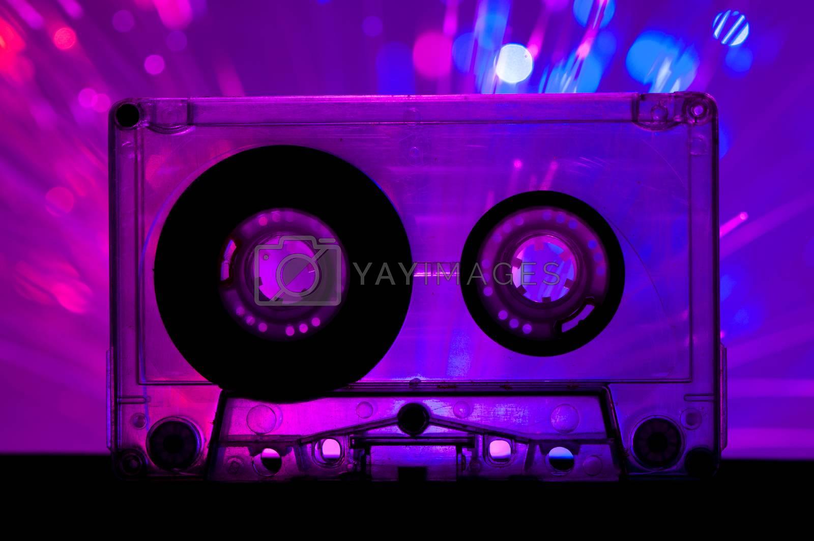 Transparent Cassette tape and blue pink color disco light background