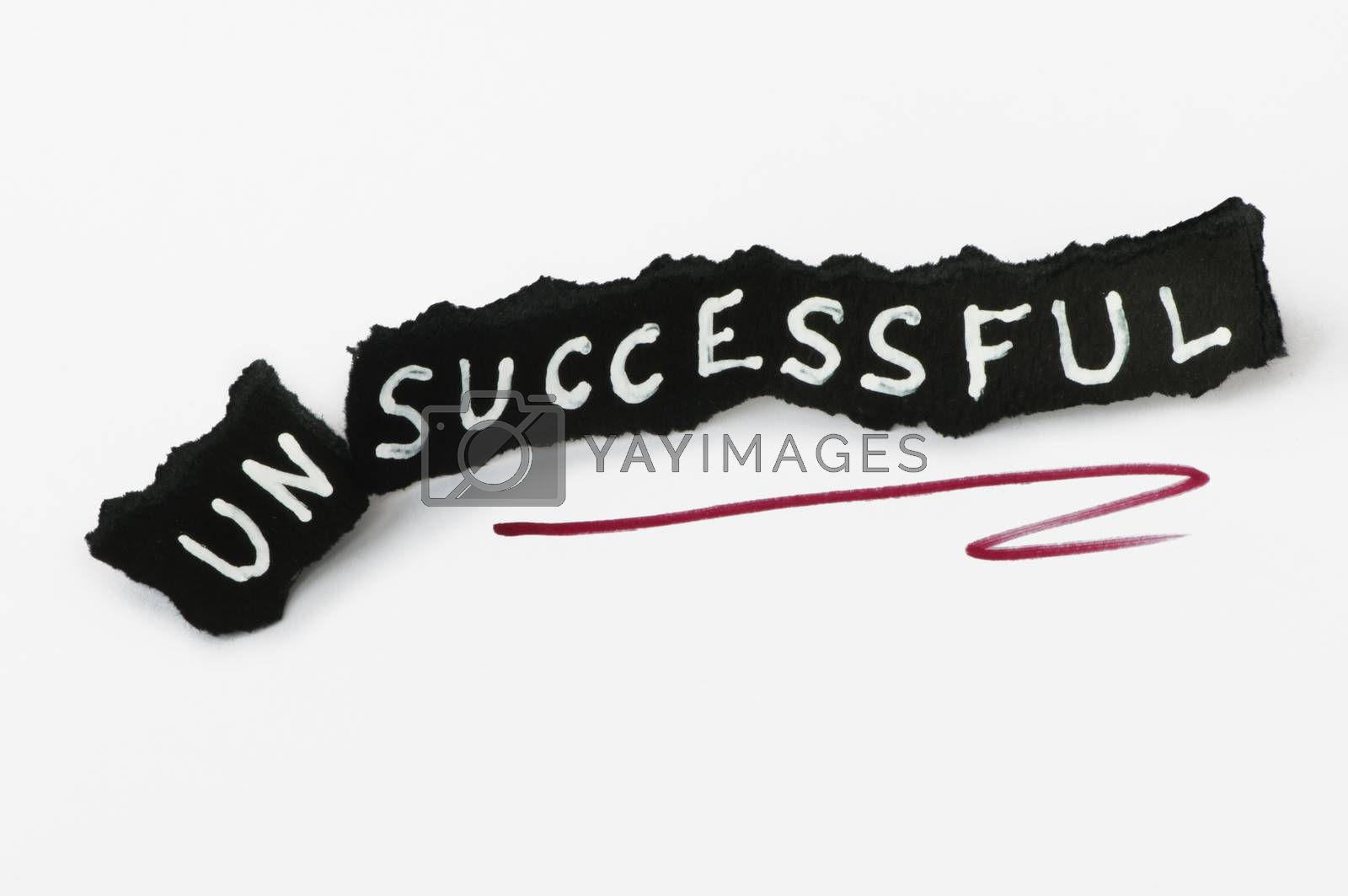 Success text over black paper. Unsuccessful and successful conception