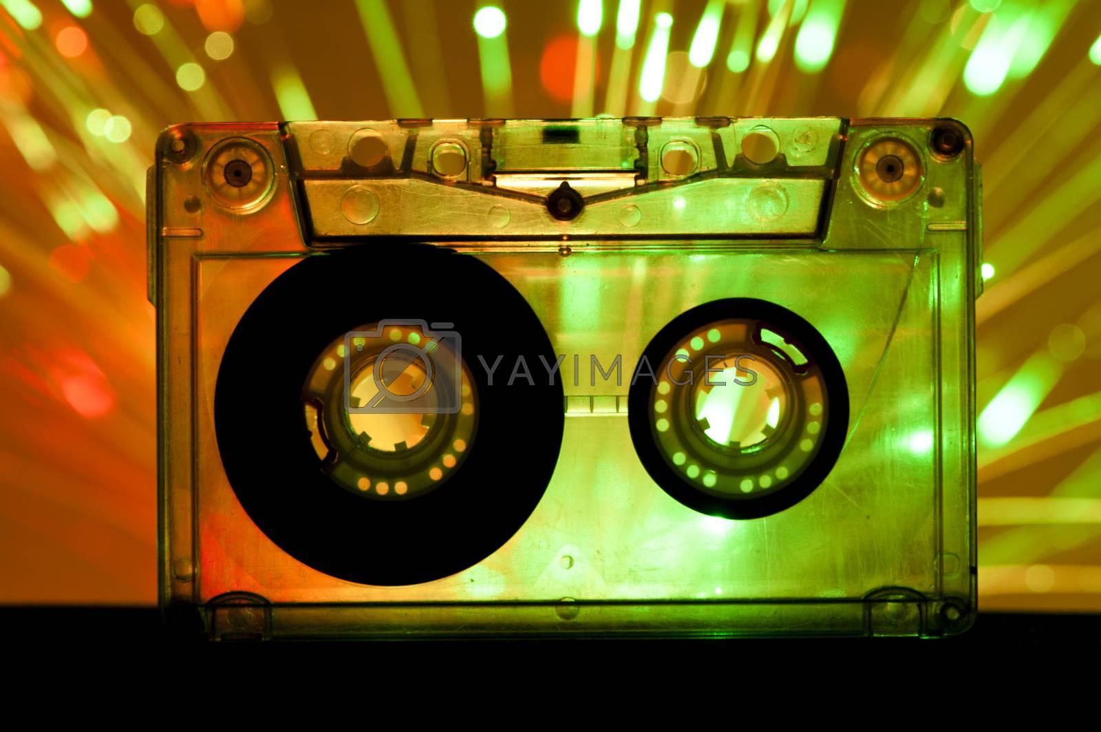 Transparent Cassette tape and green orange color disco lights background