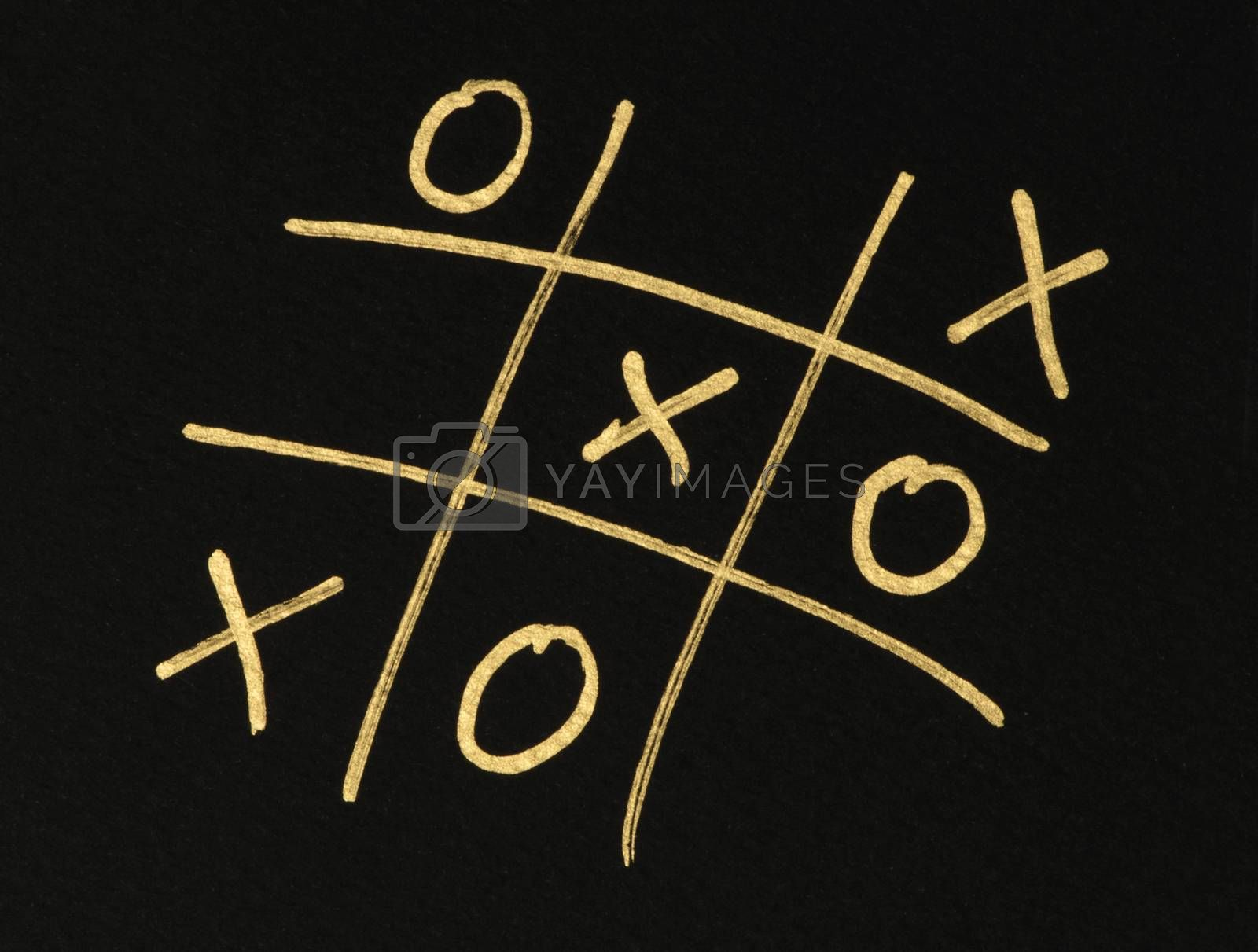 Hand-drawn tic-tac-toe game. Gold color text over black