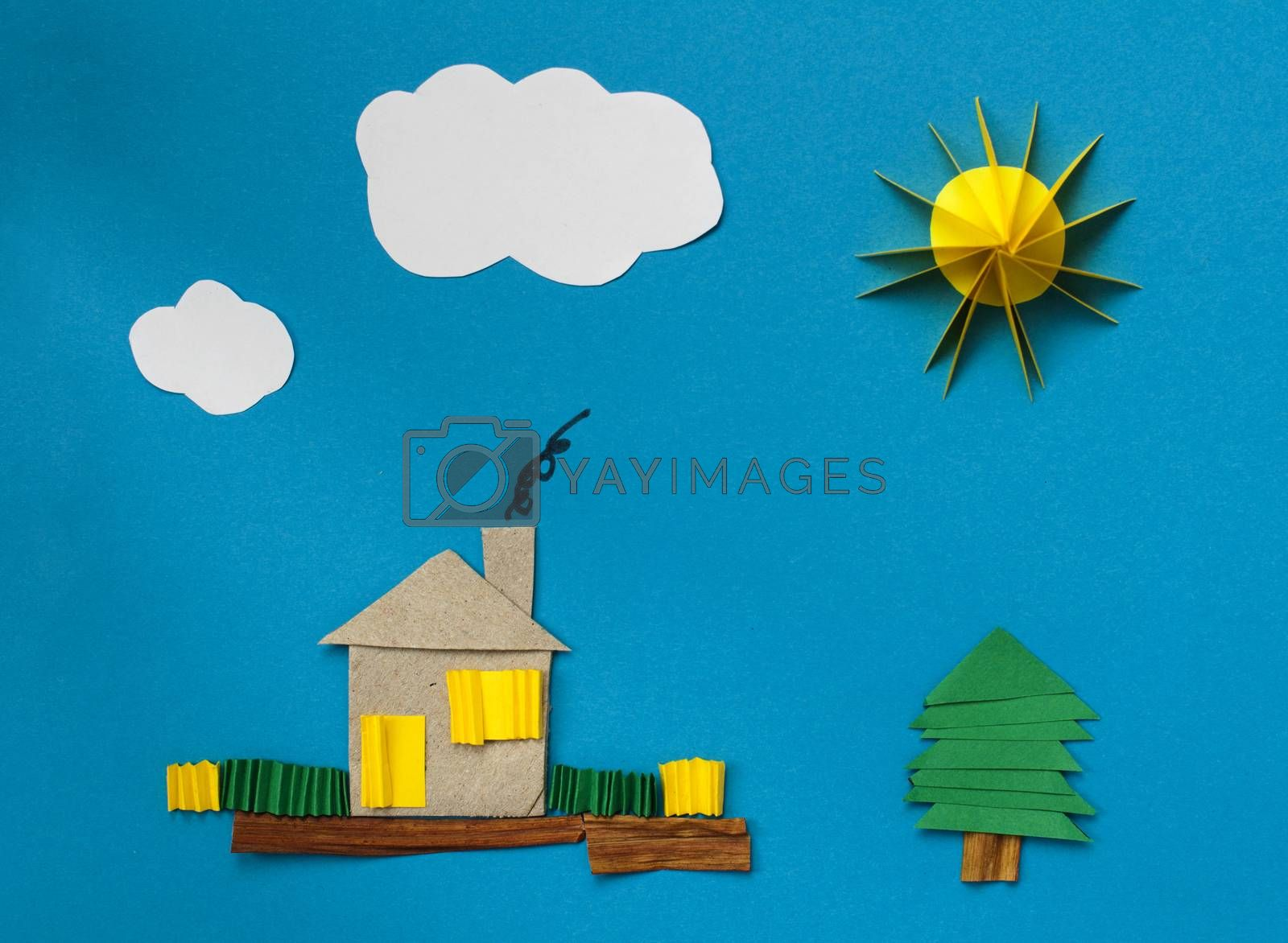 House made ​​of paper over blue paper background