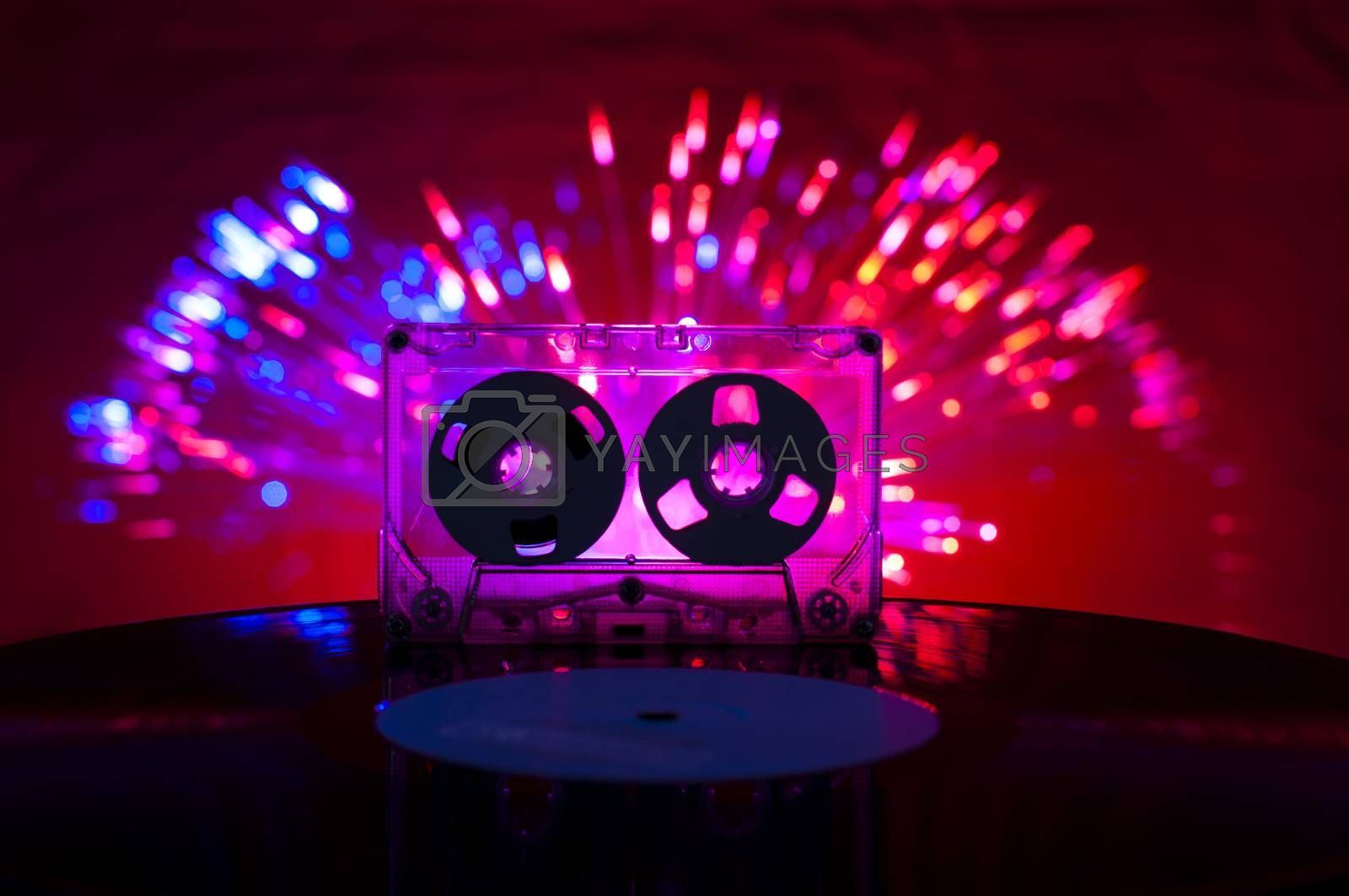 LP vinyl record, cassette tape and disco lights by deyan_georgiev