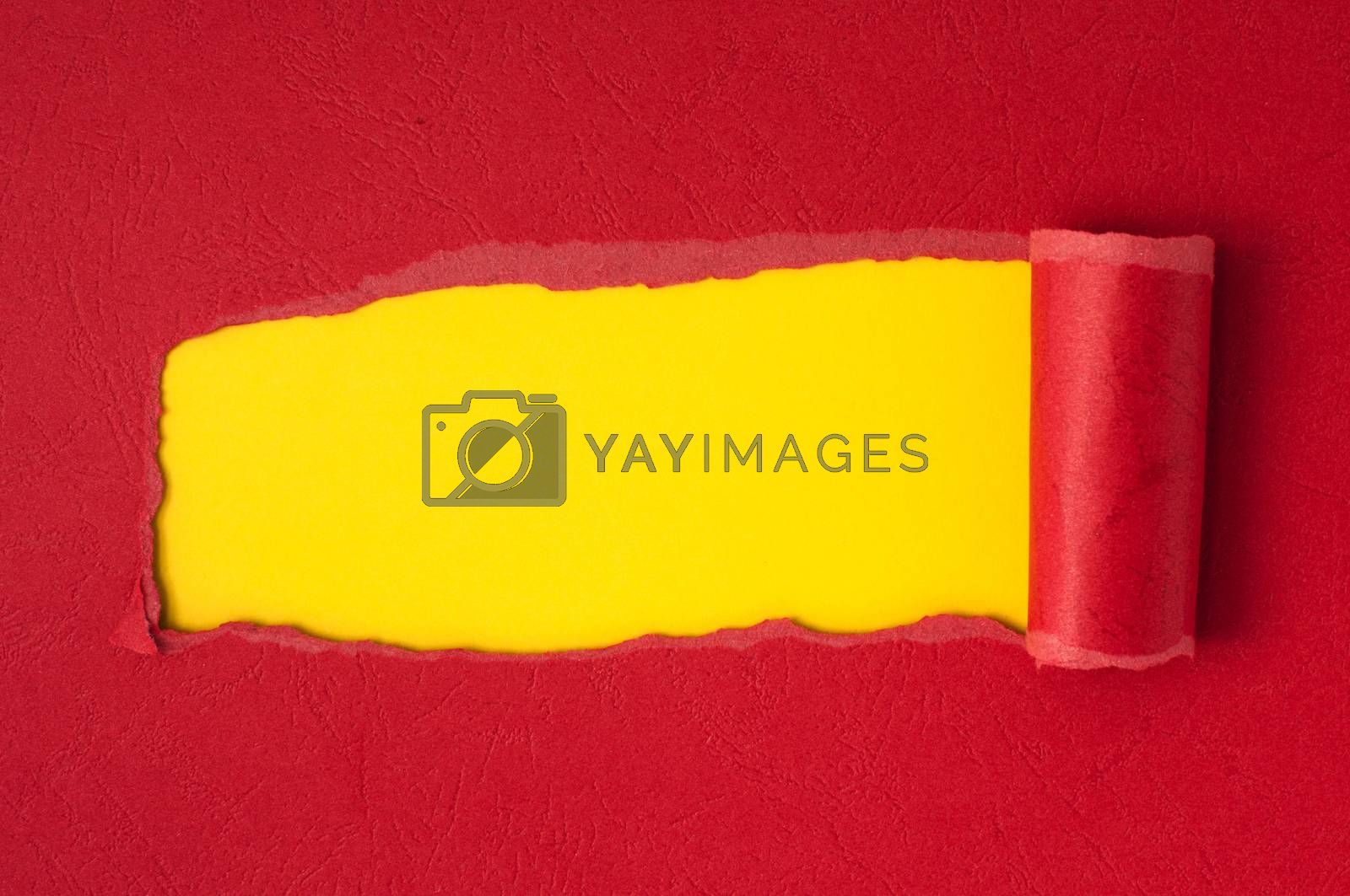 Red torn paper with yellow space for text or other content