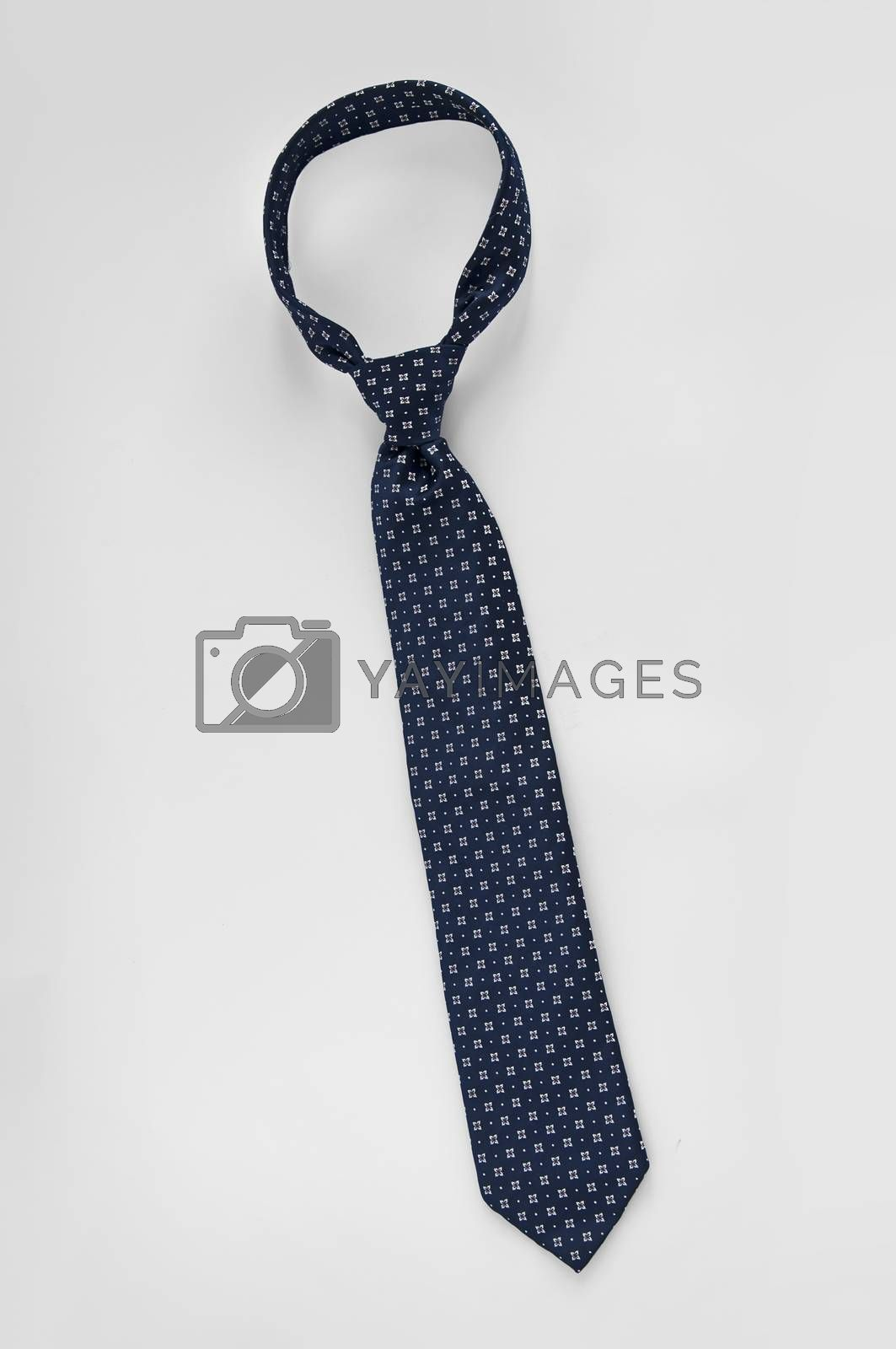 Closeup of a blue business tie isolated white background