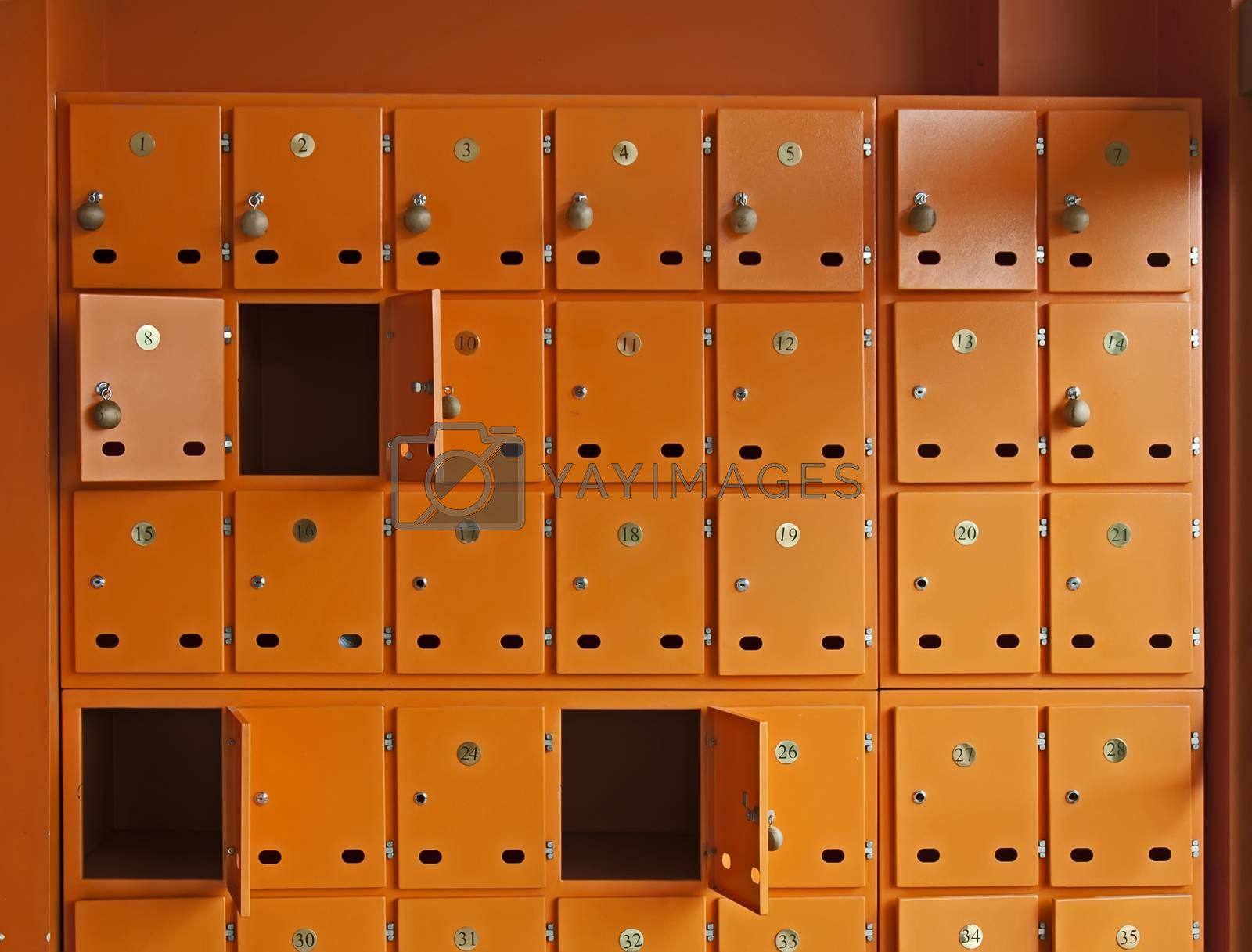 Many orange mailboxes. Some of them opened