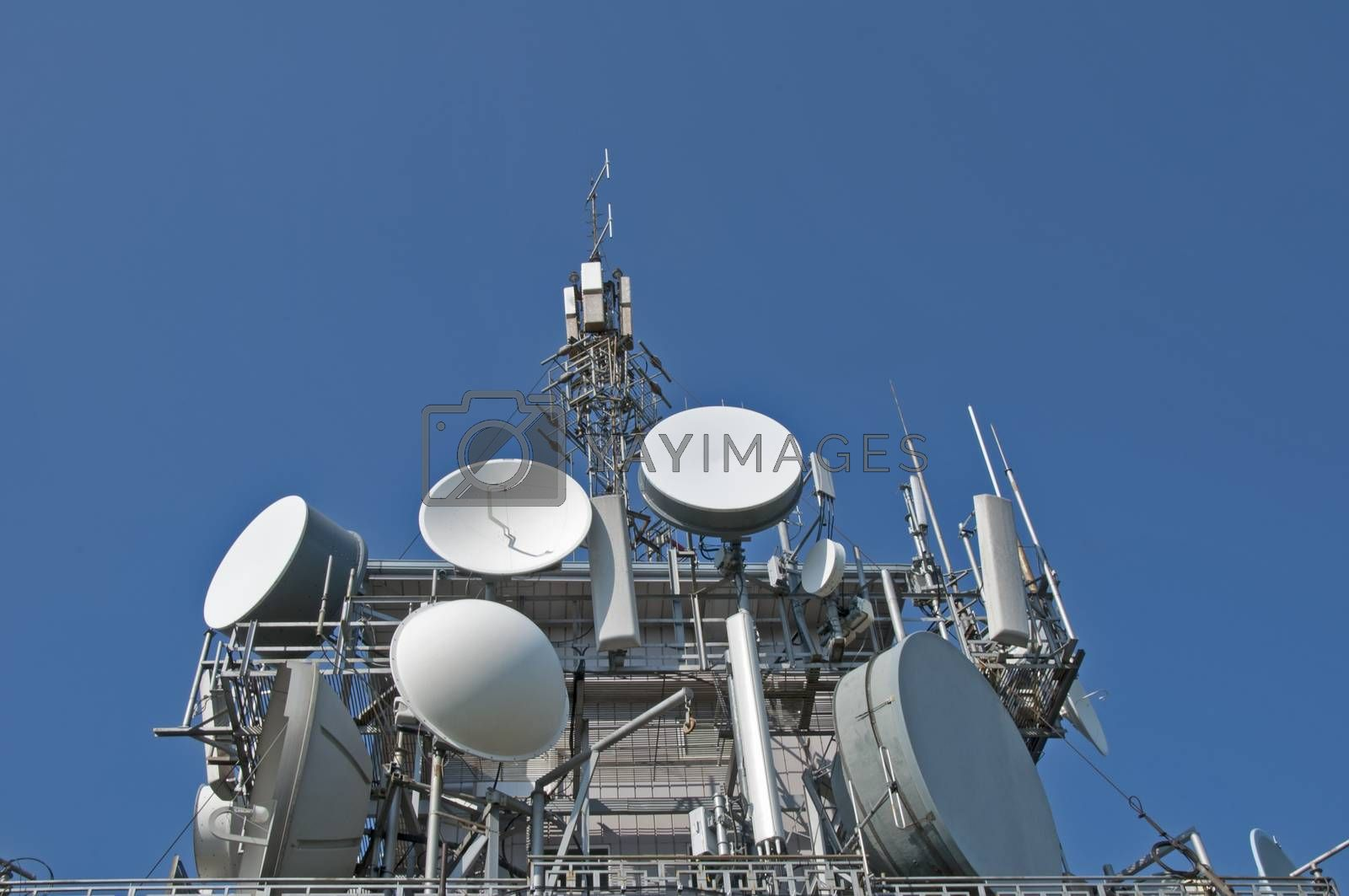 Transmitters, antennas and repeaters on building