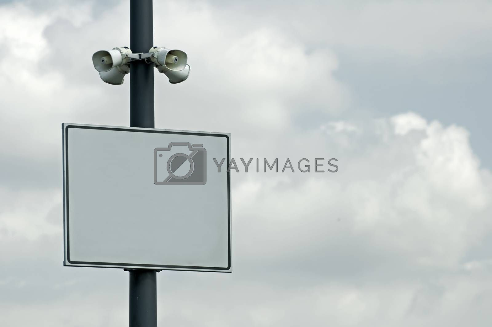 Speakers and plate on blue sky background