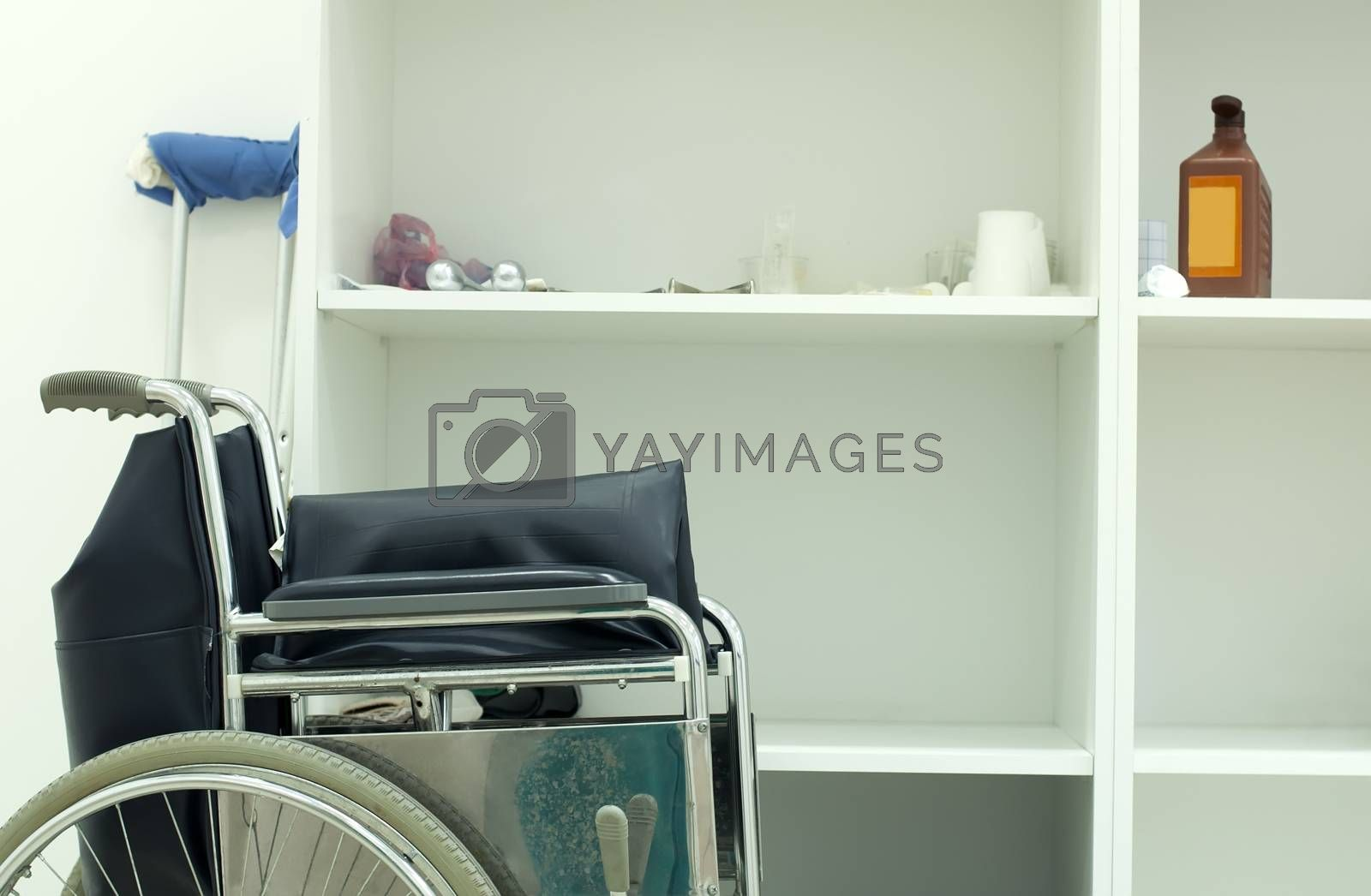 Medical orthopedic surgery with wheelchair and crutches
