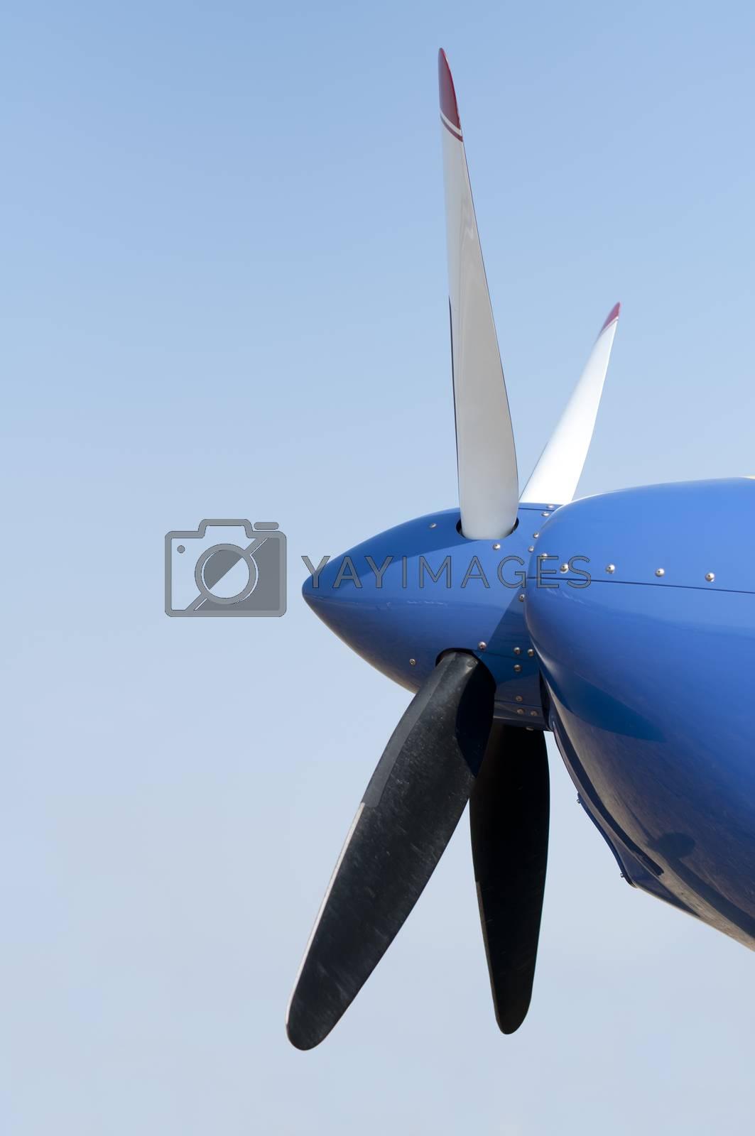 White plane propeller on blue sky background