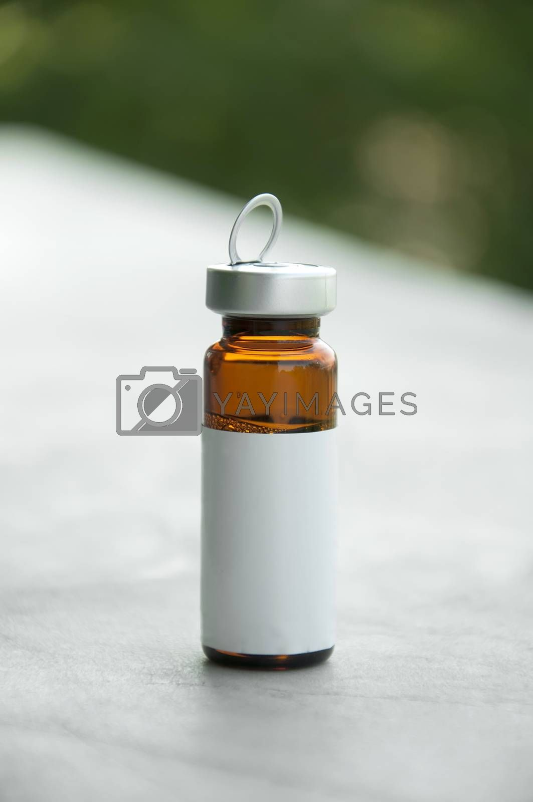 Small bottle for medicines. With white empty label