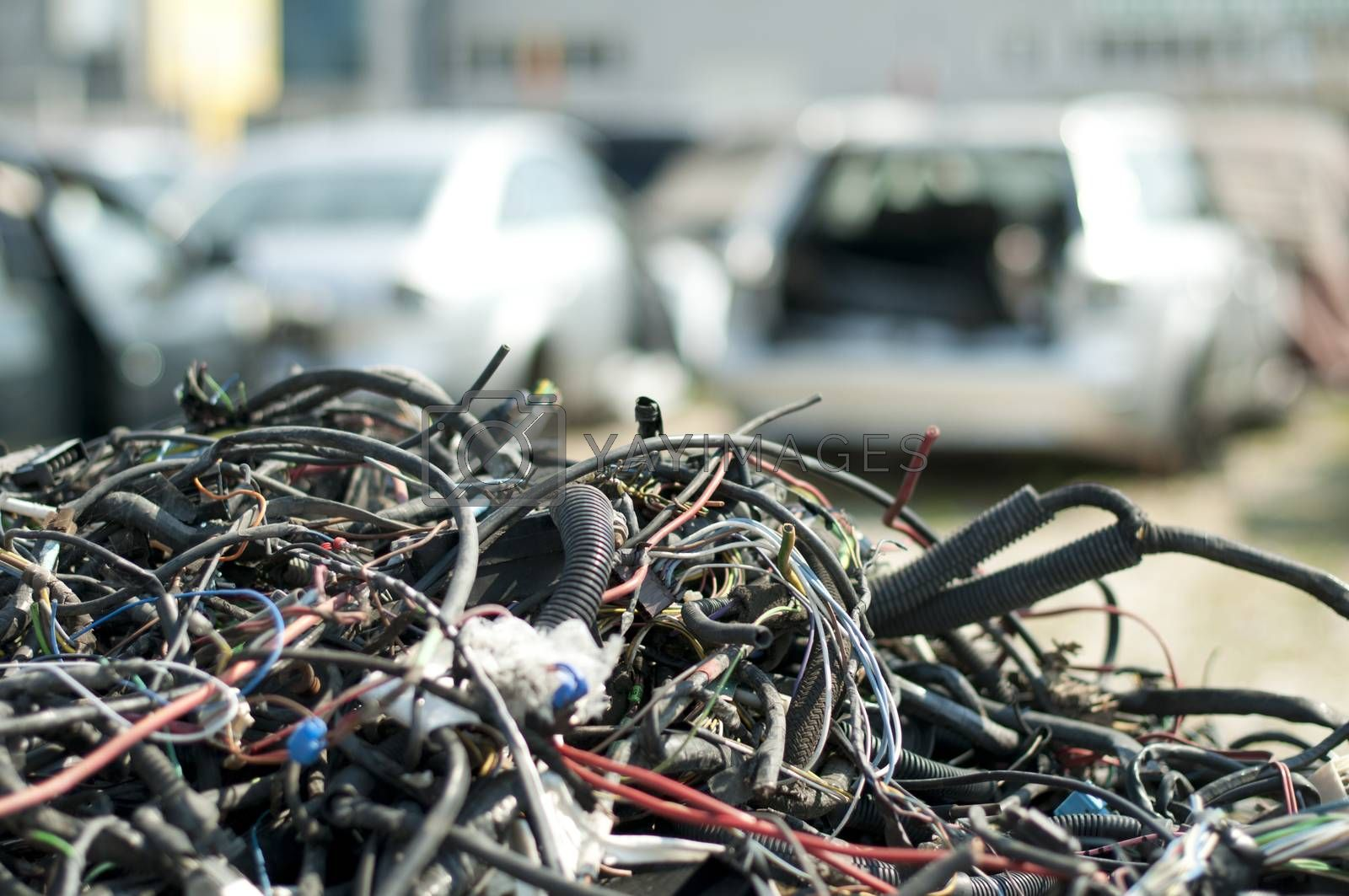 Old car parts and cables in Automorgue. Blurred cars on background
