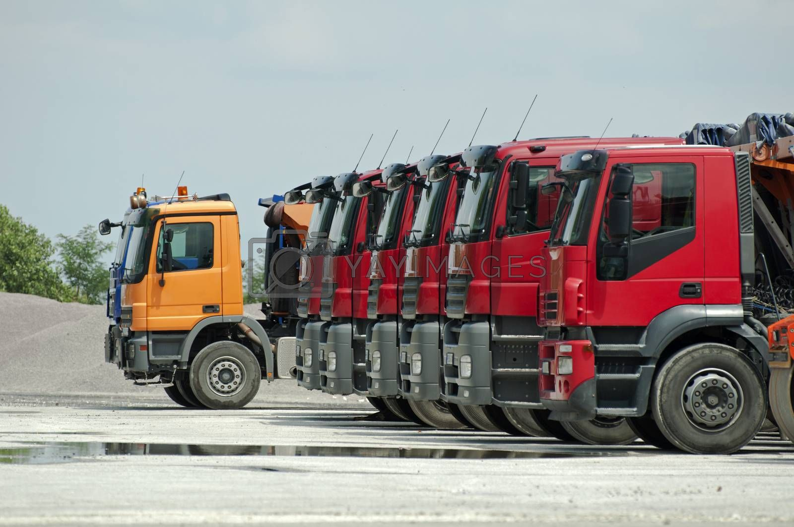 Trucks, rollers and machinery for asphalting. Horizontal image