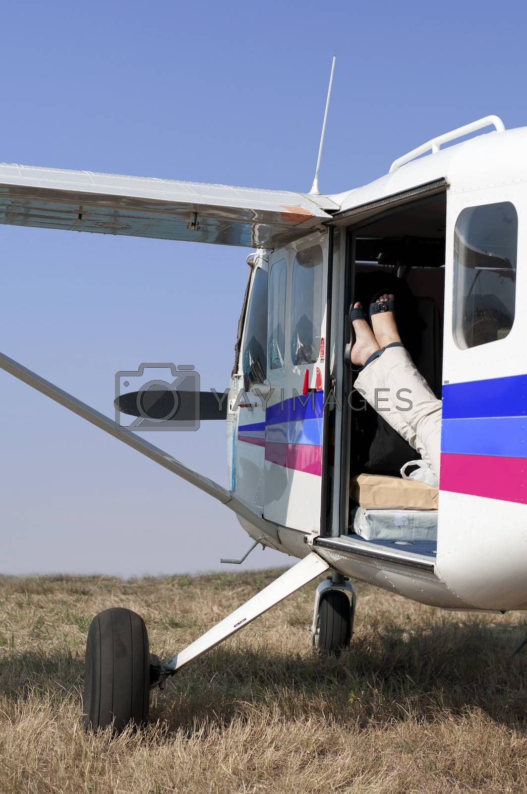 Female legs in a helicopter leaning against the door