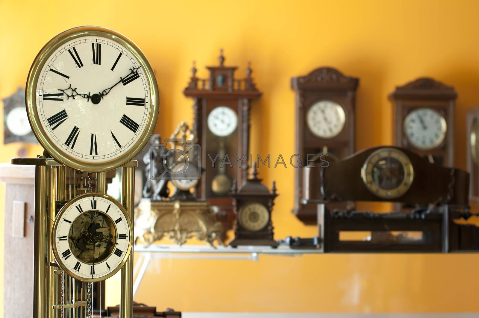 Old antique clocks close up and blurred background clocks