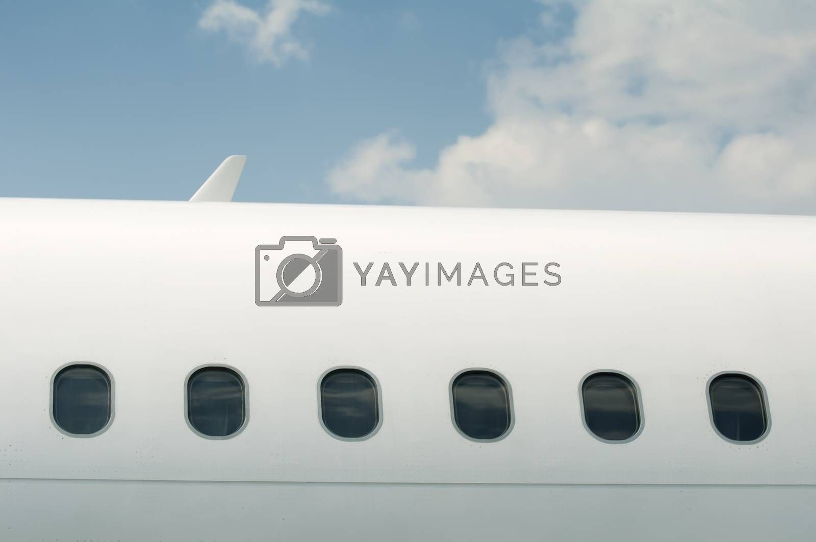Windows of an airplane outside. White color plane
