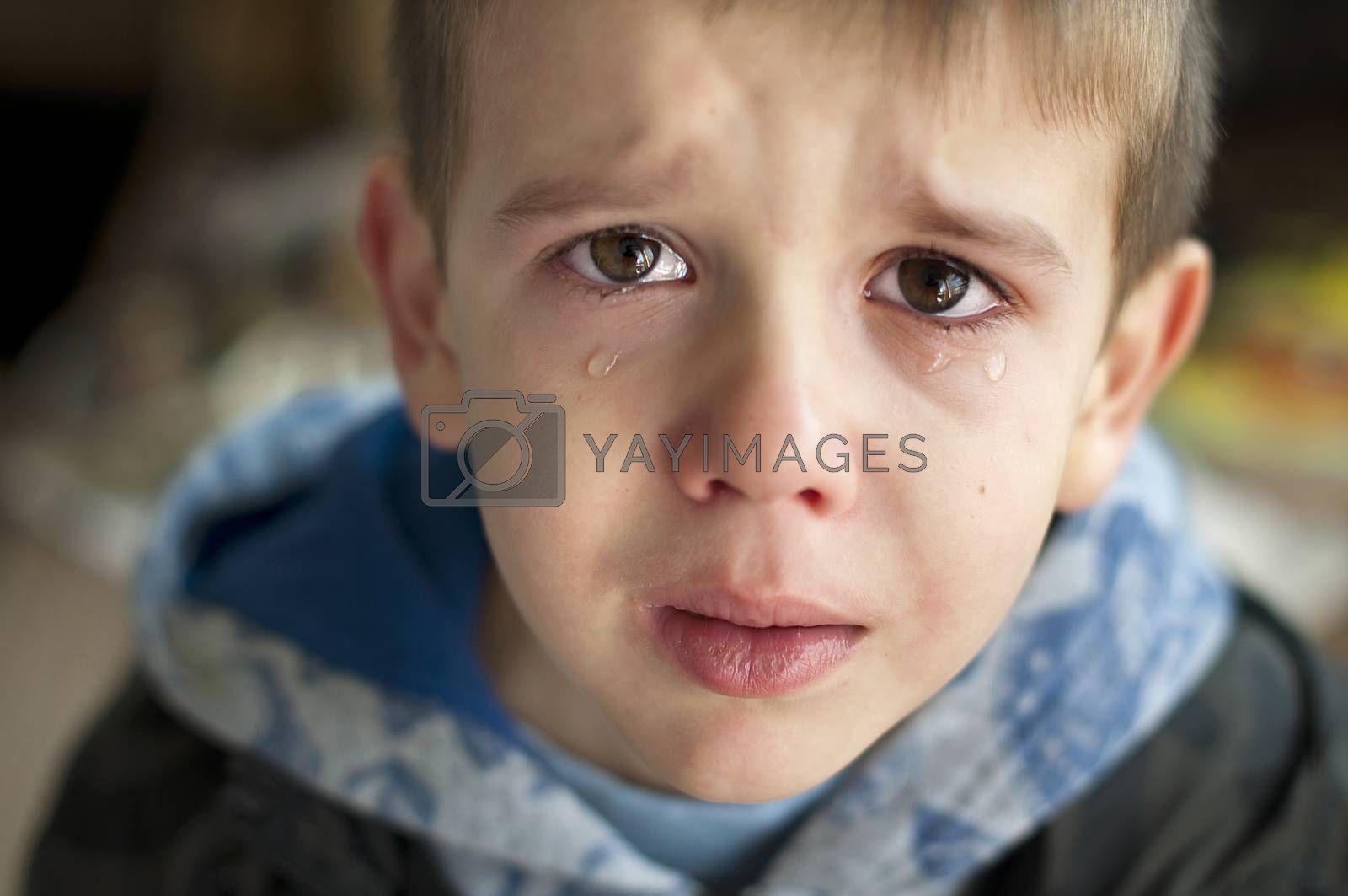 Sad child who is crying. Close up