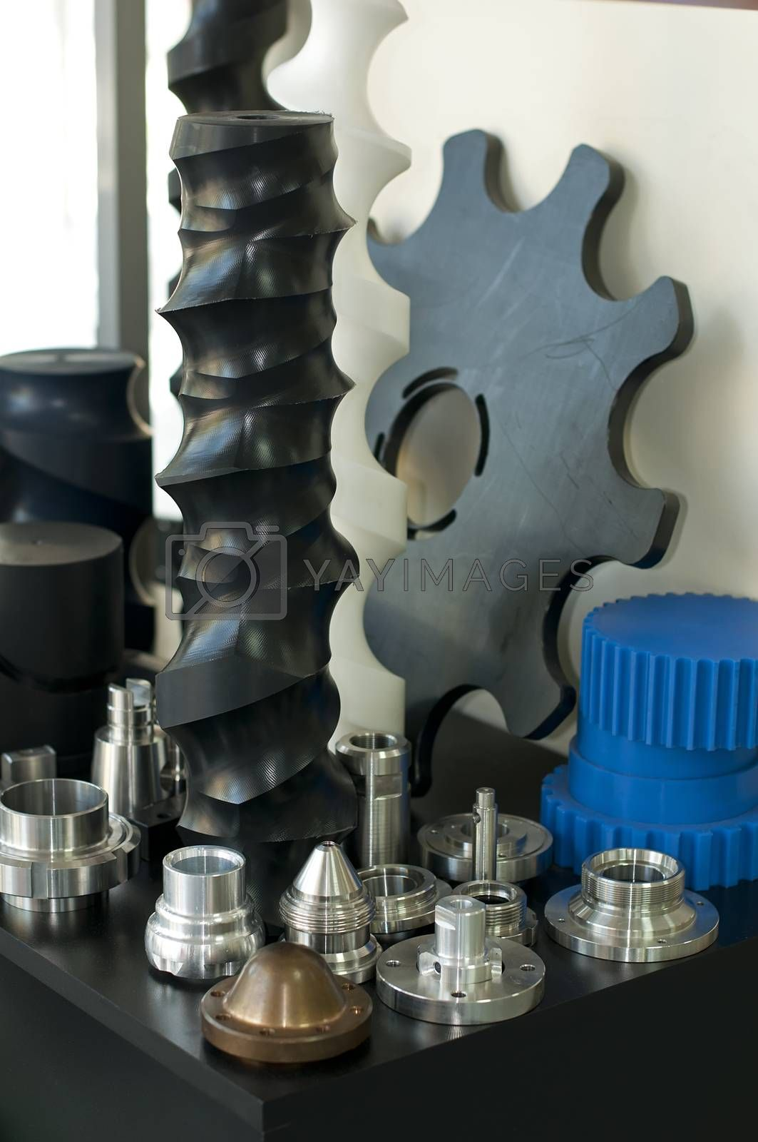Plastic and metal machine parts. Vertical imagel