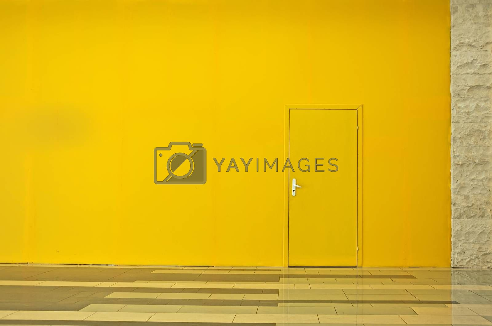 Yellow wall with a door. Horisontal background