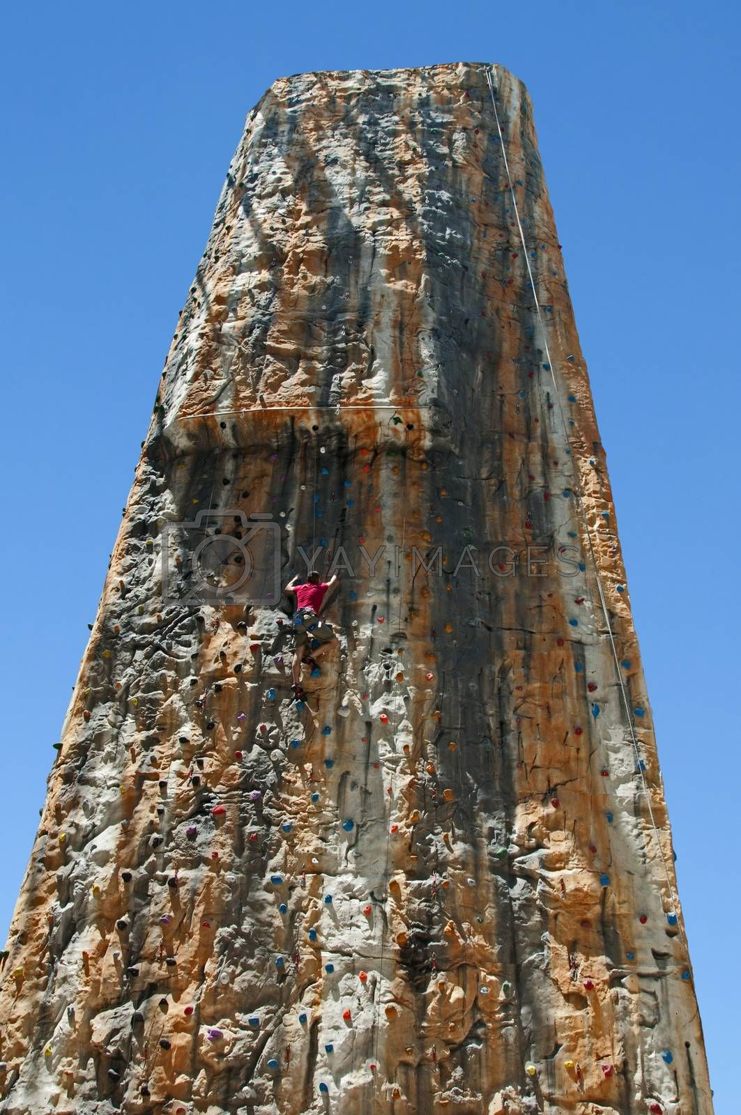 Boy on a big climbing wall, on vertical