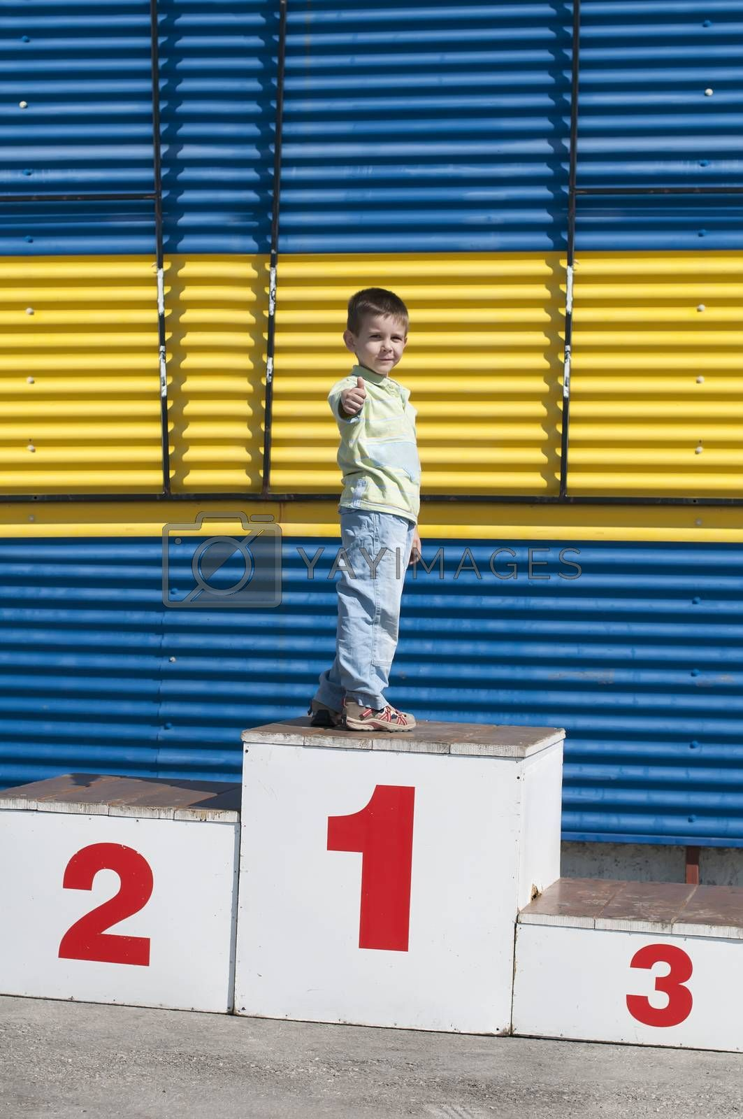 Little boy on the podium. First place
