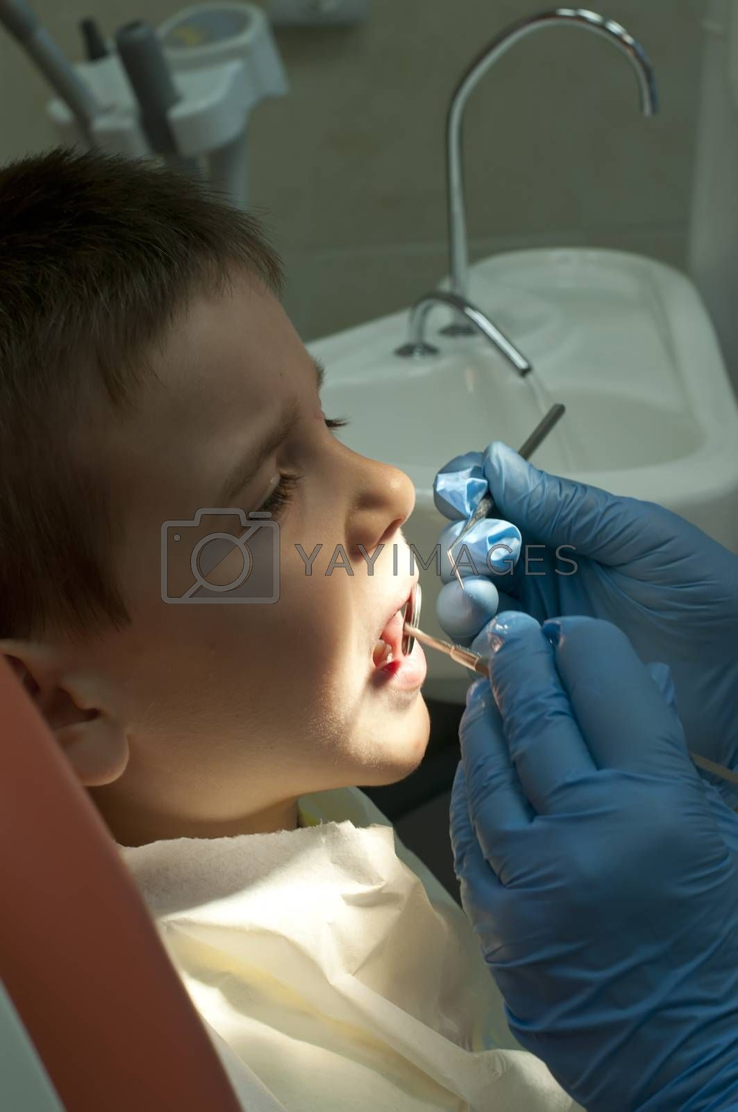 Child in a dentist's chair in cabinet