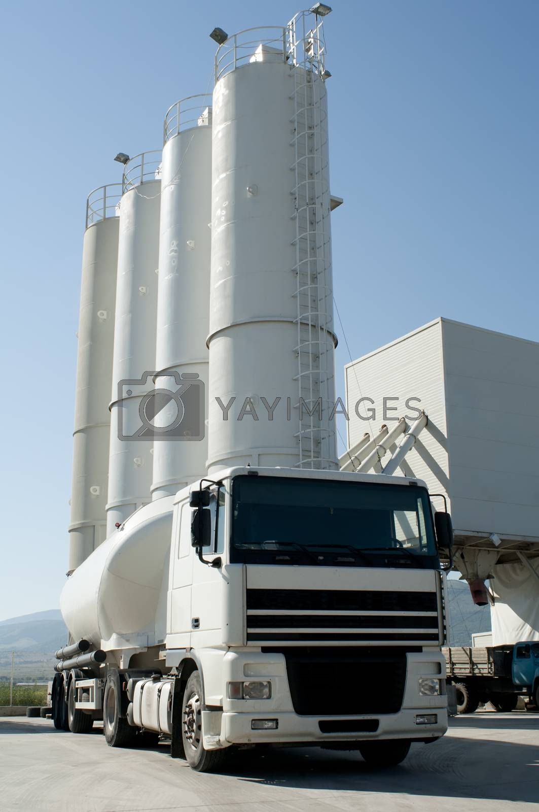 Cement factory with silos and mixer truck by deyan_georgiev