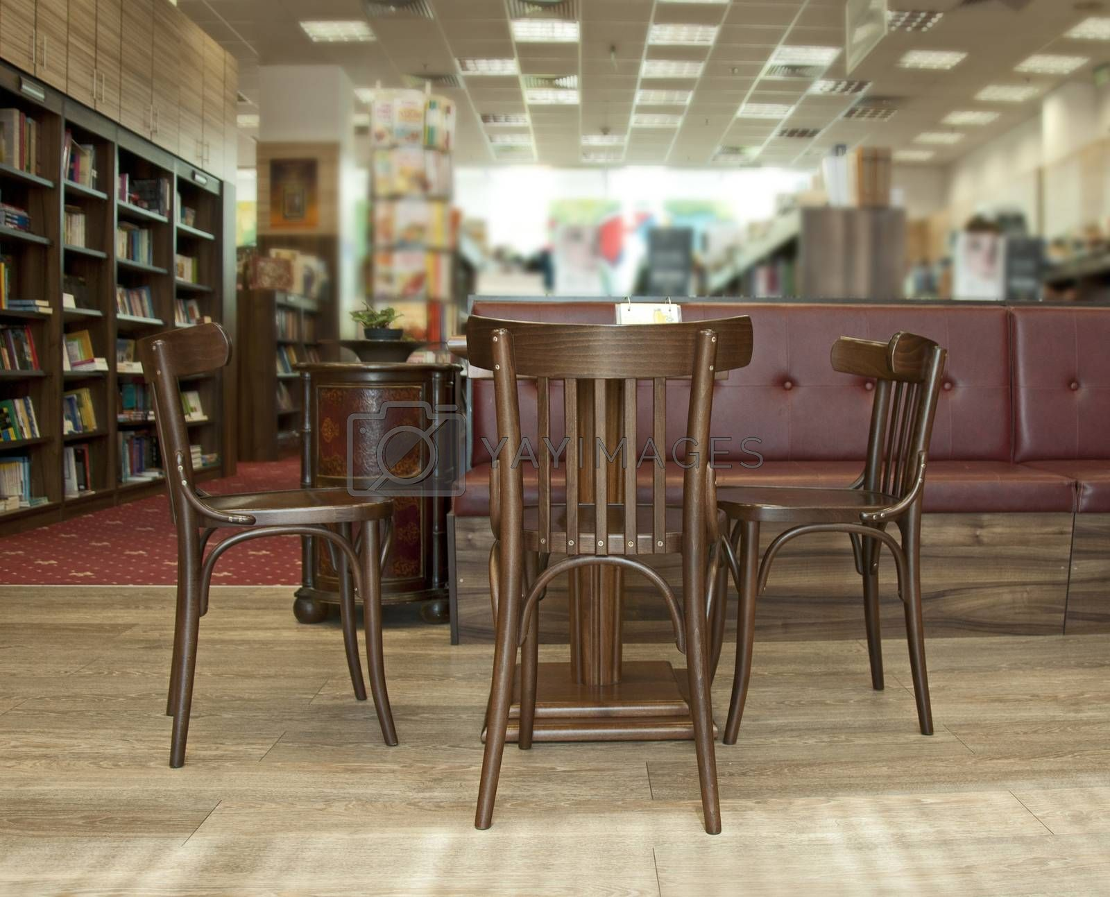 Library with chairs and table. A lot of books