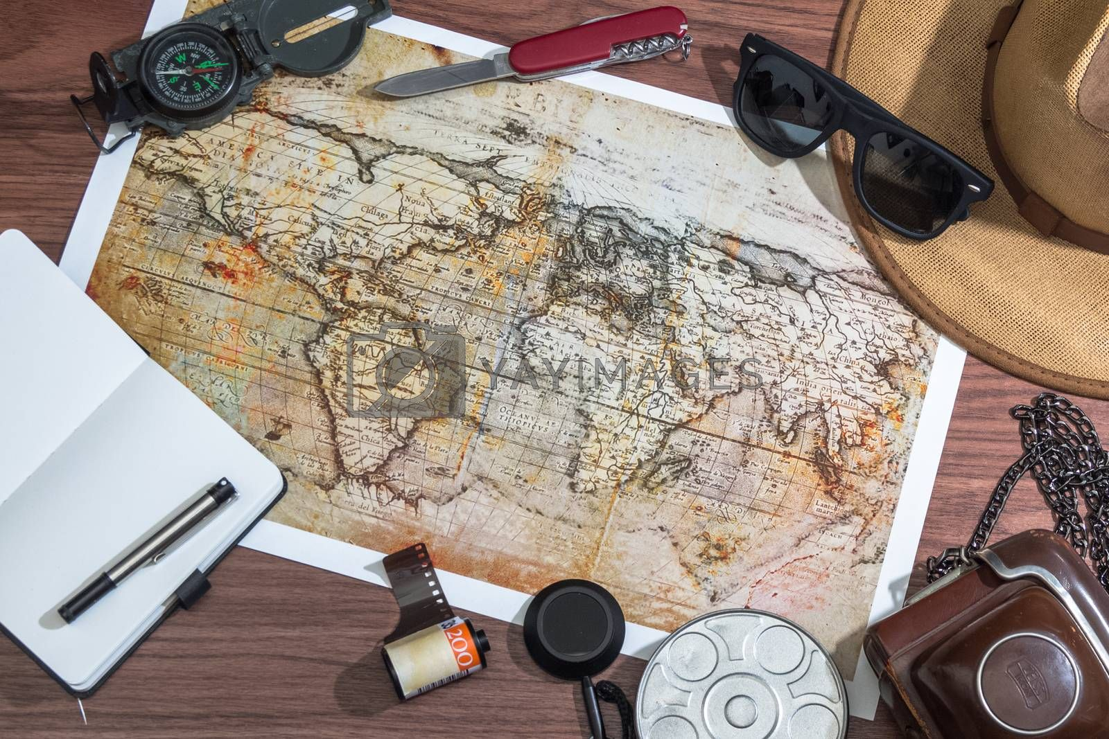 Travel concept on wooden background, top view