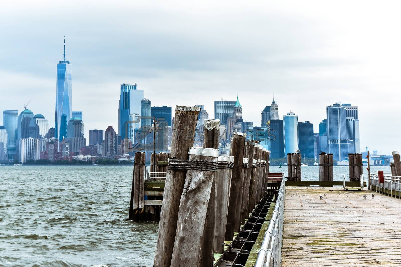 Cityscape of the financial district of Manhattan from Liberty Island, in a foggy day.