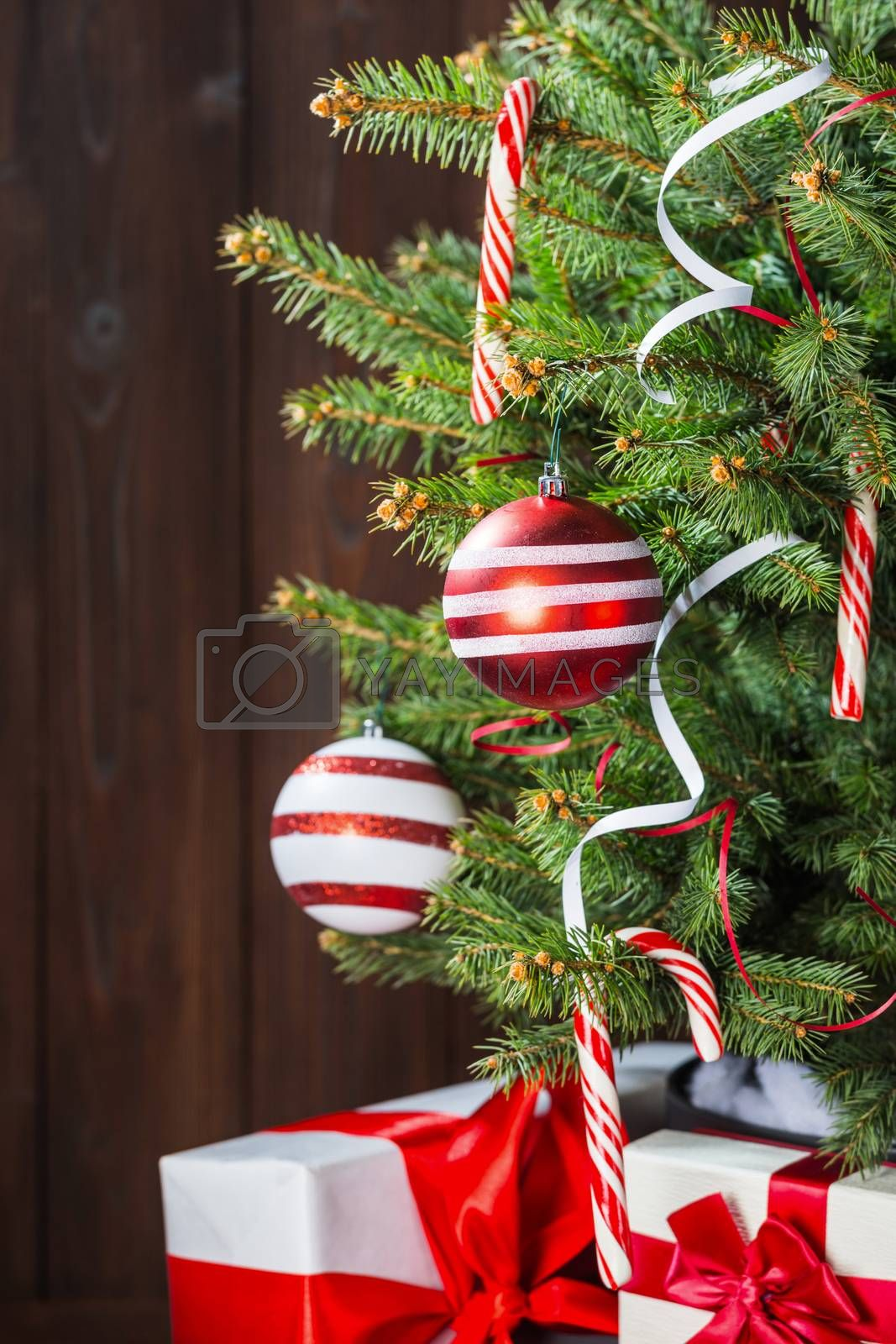 Decorated Christmas tree and gift boxes background