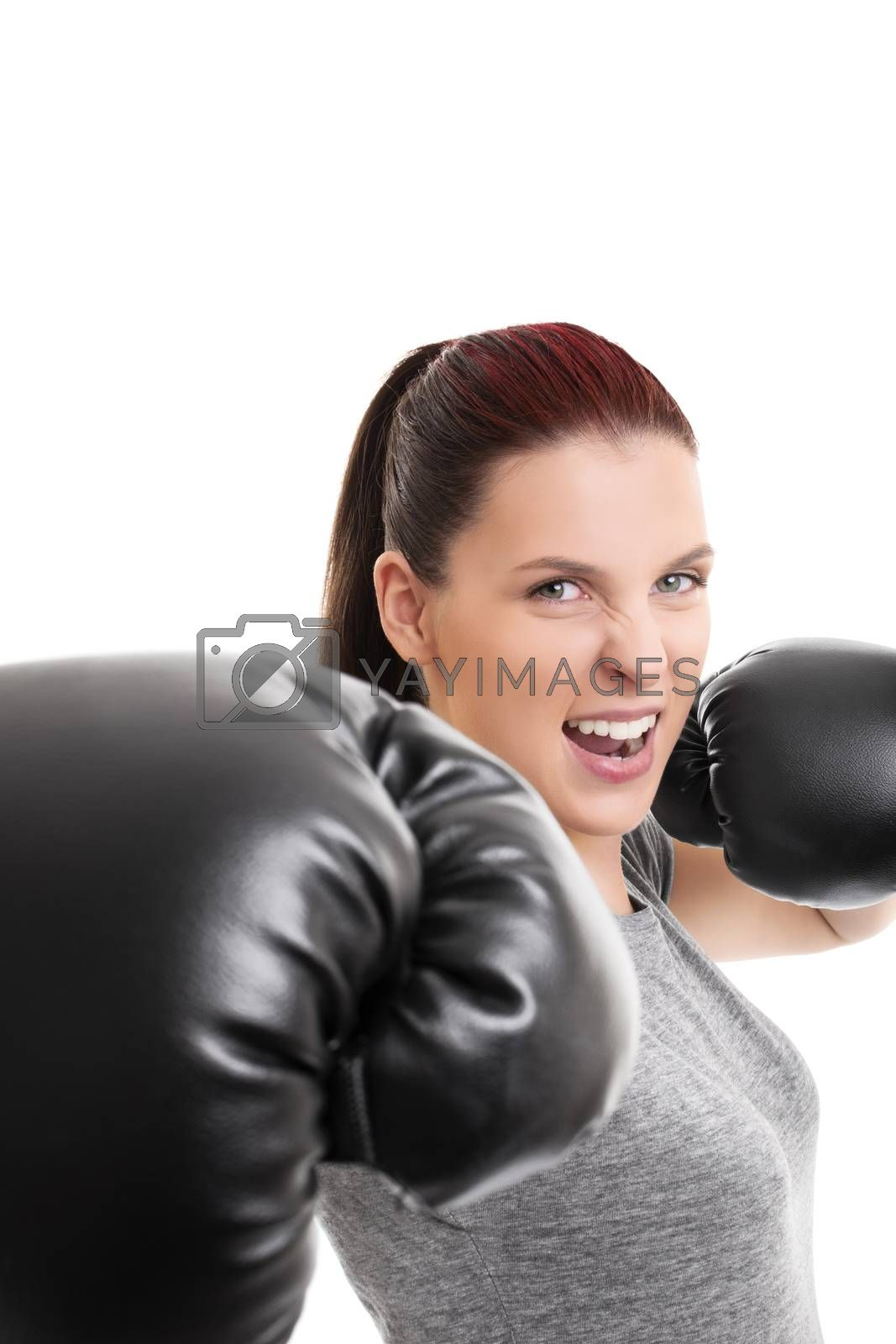 Beautiful girl with boxing gloves punching the camera by Mendelex