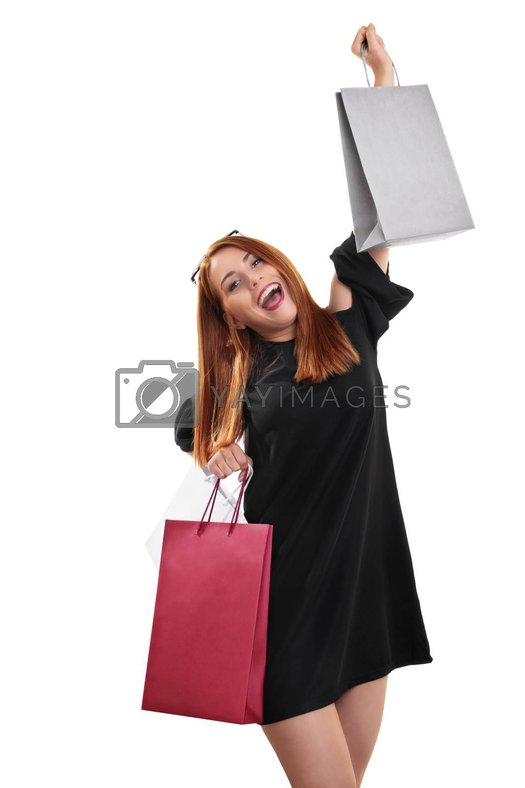 Excited and happy young woman with shopping bags by Mendelex