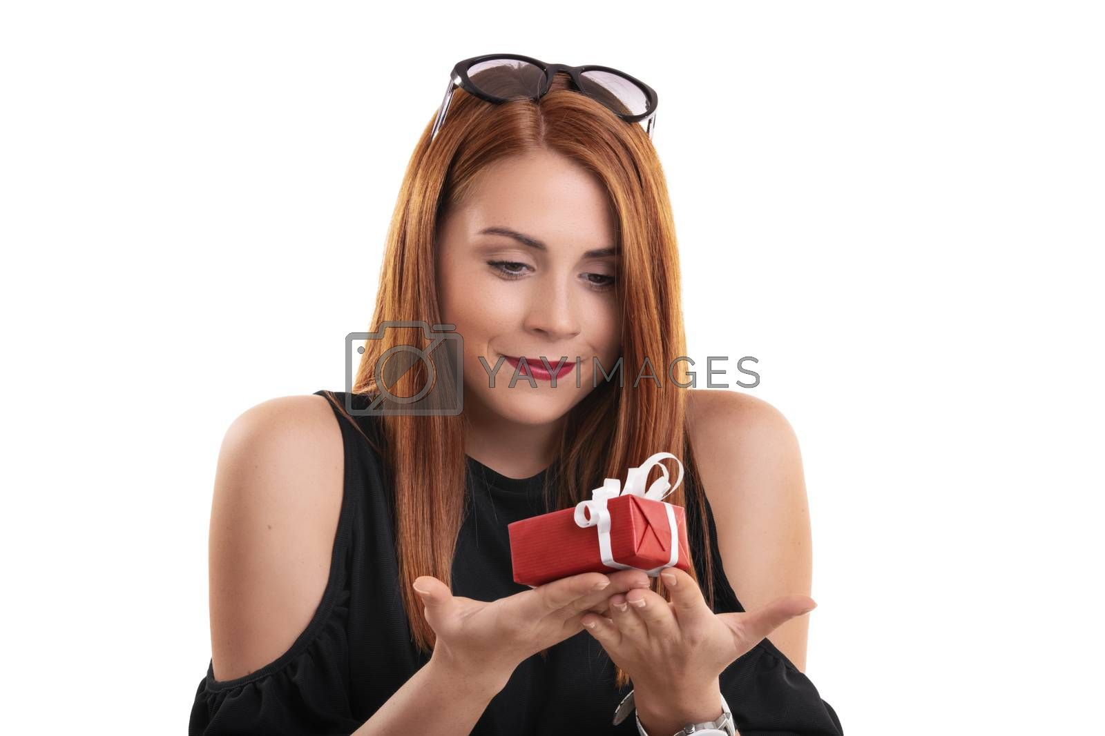Smiling girl holding a small wrapped gift box by Mendelex