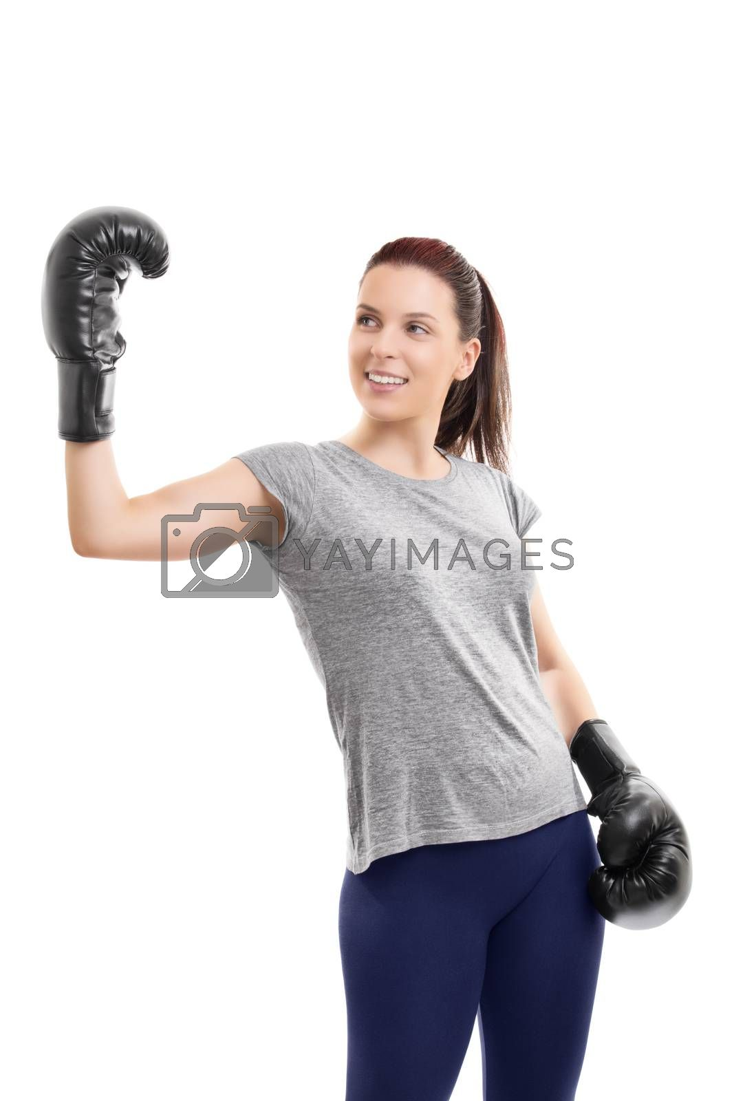 Girl with boxing gloves raising hand in celebration by Mendelex