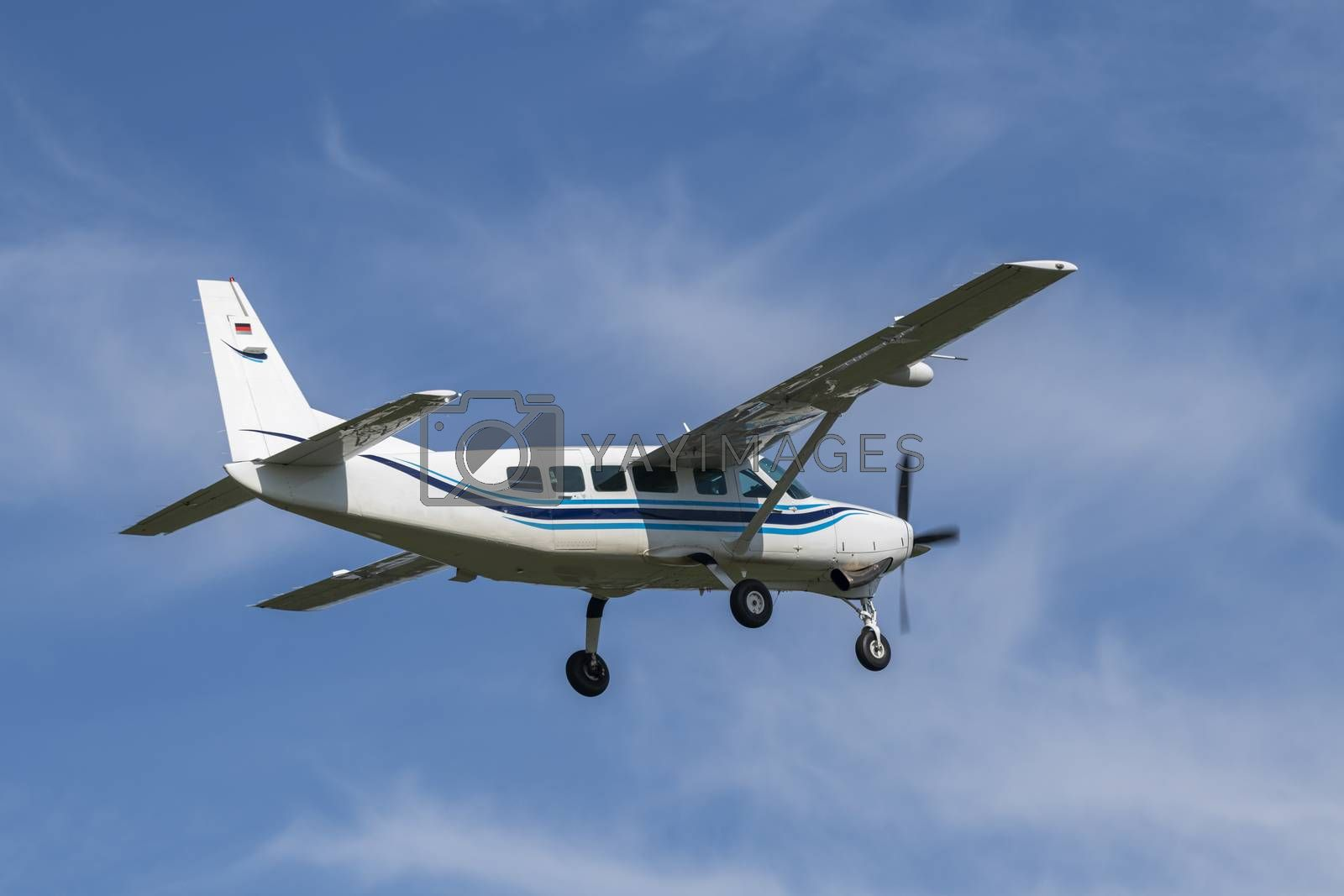 Single-engine business airplane during take off  by Tofotografie
