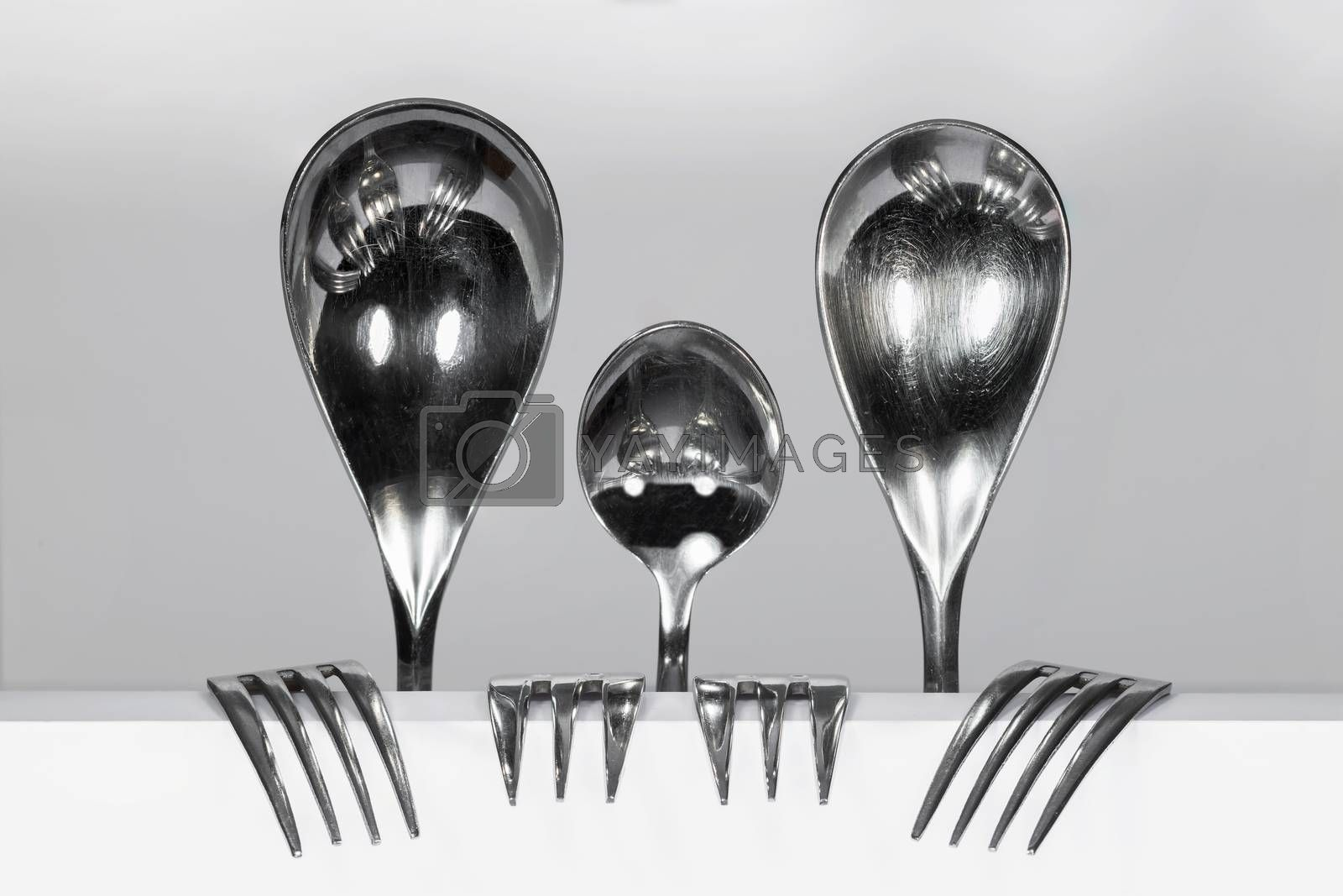Cutlery Family of three spoons and four forks   by Tofotografie