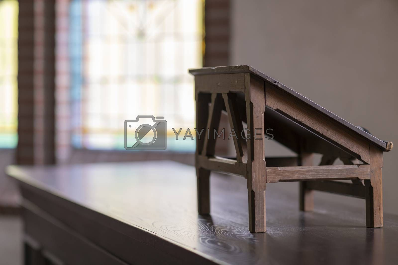 Lectern in an old church  by Tofotografie