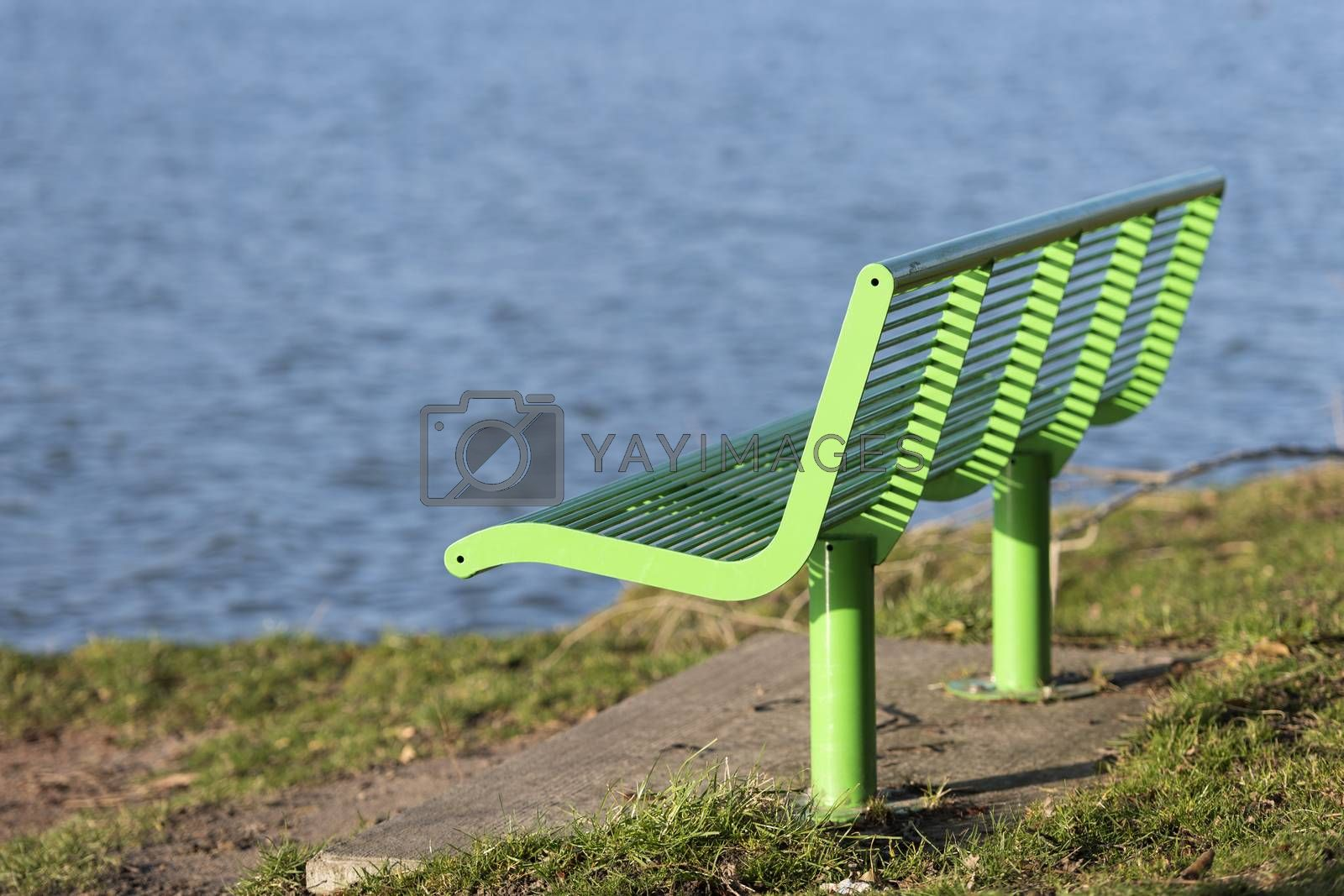 Green bench on the waterfront  by Tofotografie