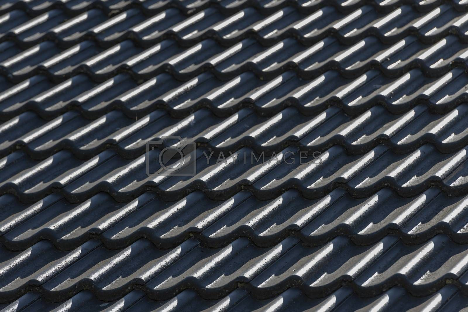 Roof hung with gray concrete roof tiles as background picture