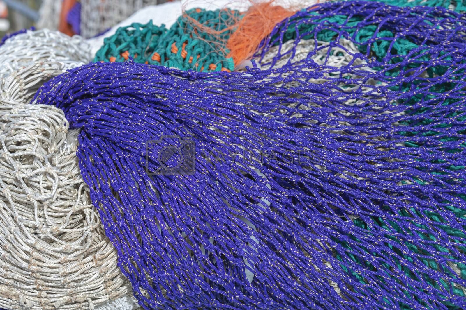 Multi colored fishing nets in a Dutch port in the North of the Netherlands
