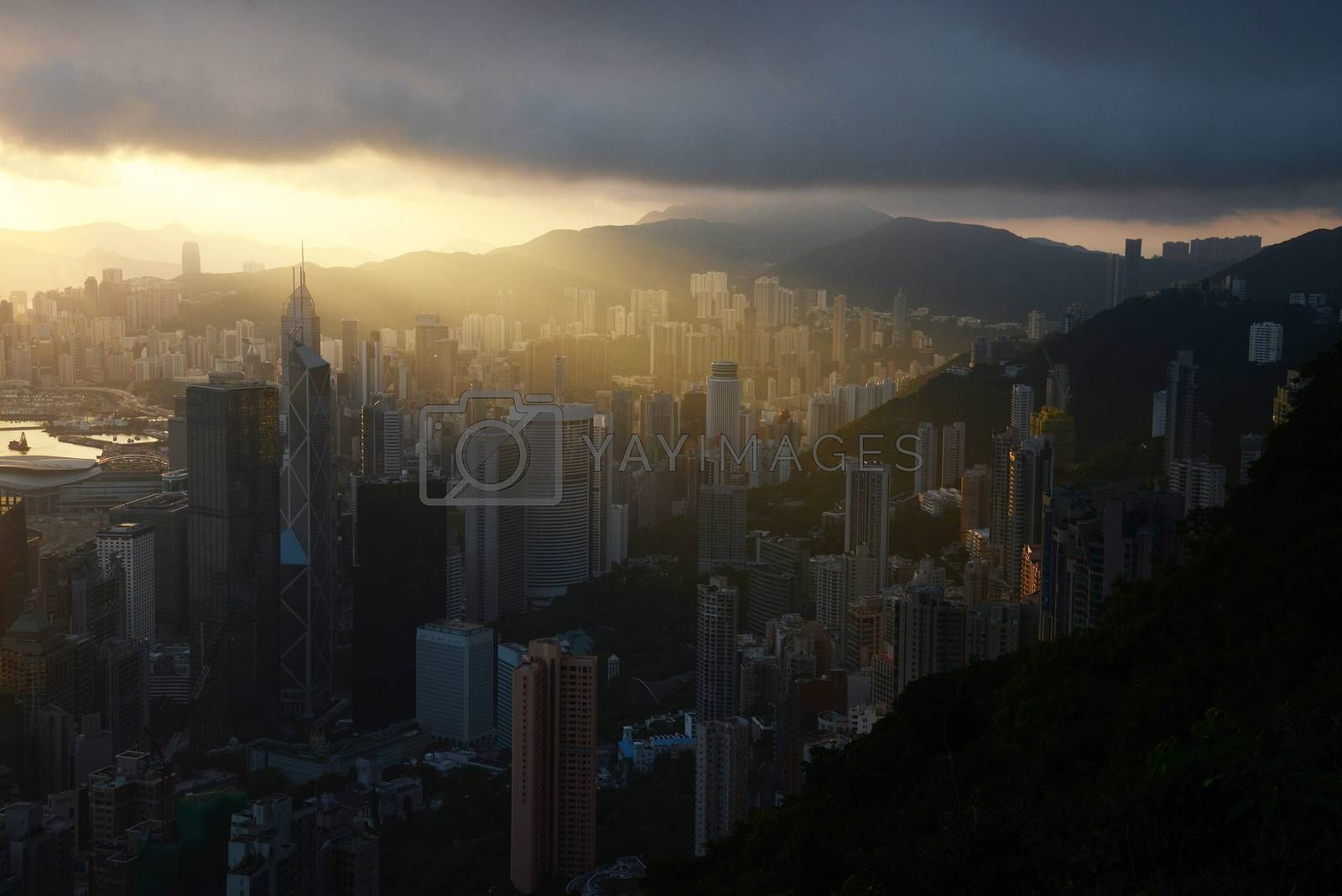 Royalty free image of sunrise from the peak by porbital