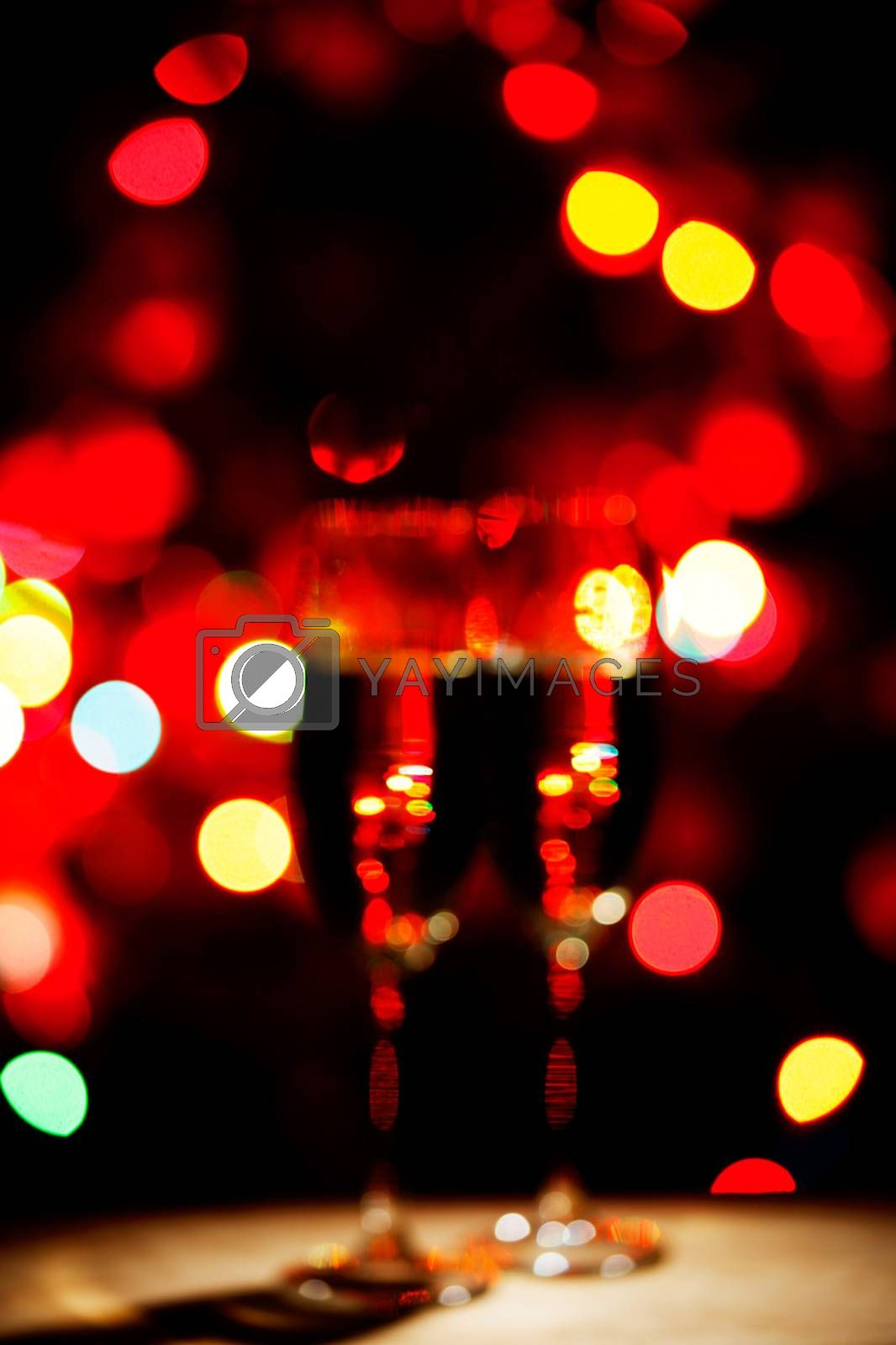 Flutes of champagne bokeh lights New year celebration concept