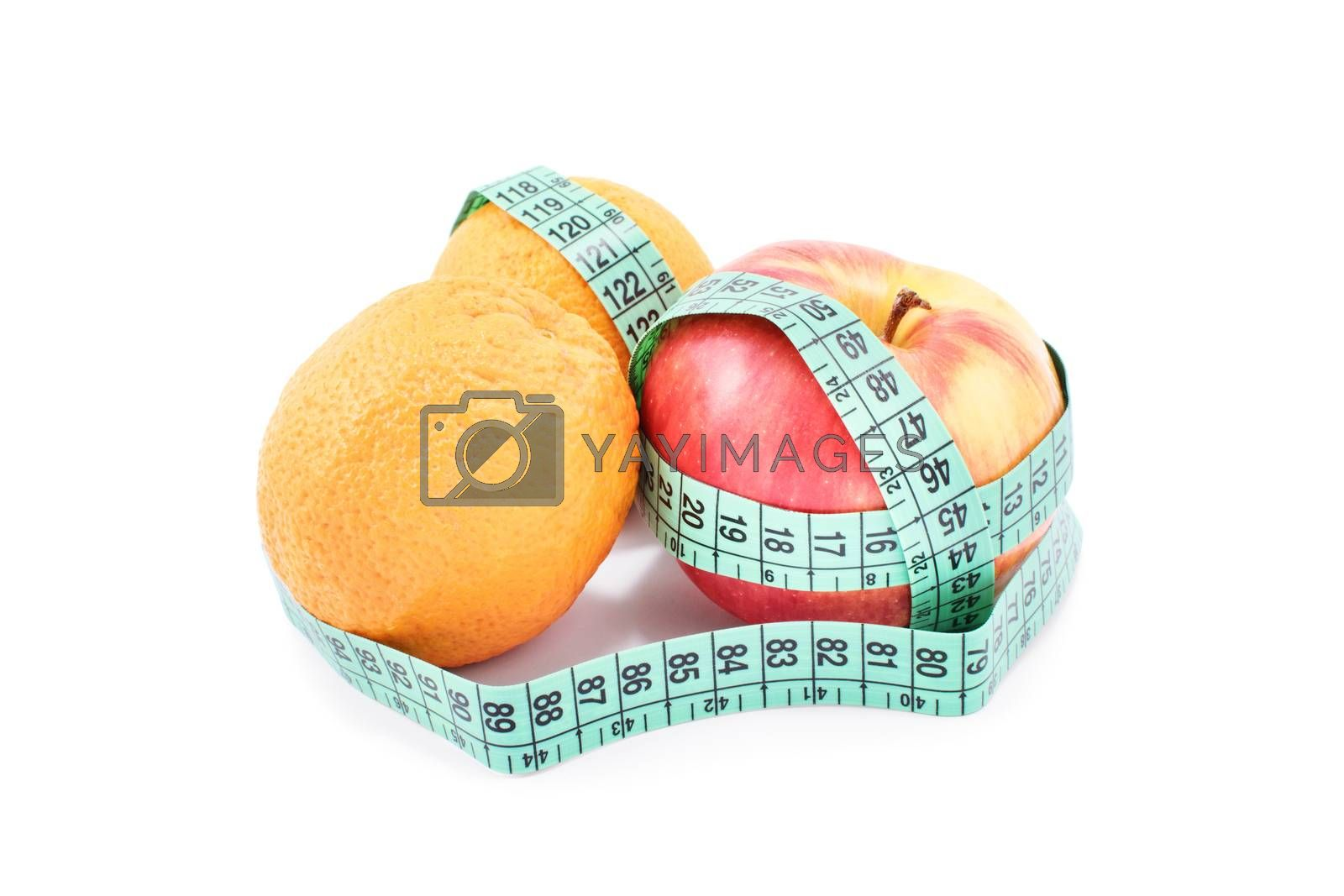 Diet, healthy eating, weight loss concept. Measuring tape wrapped around oranges and an apple, isolated on white background. Symbol of vitamin diet, slim shape and healthy food.