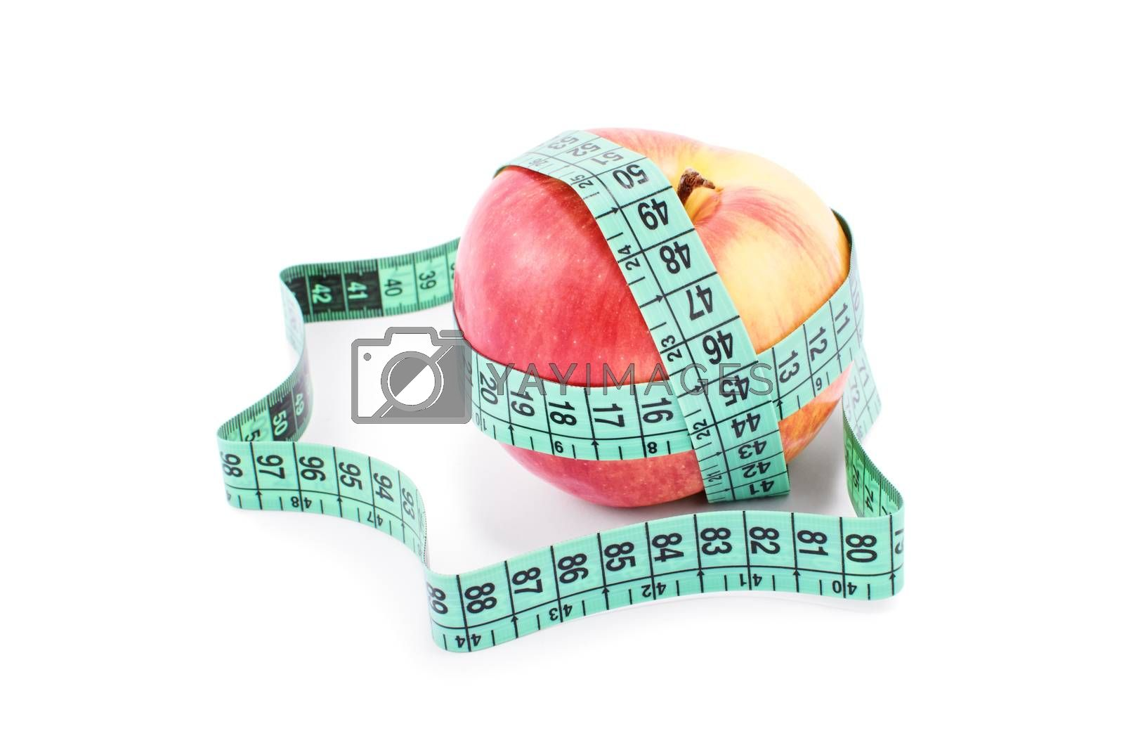 Diet, healthy eating, weight loss concept. Measuring tape wrapped around an apple, isolated on white background. Symbol of vitamin diet, slim shape and healthy food.