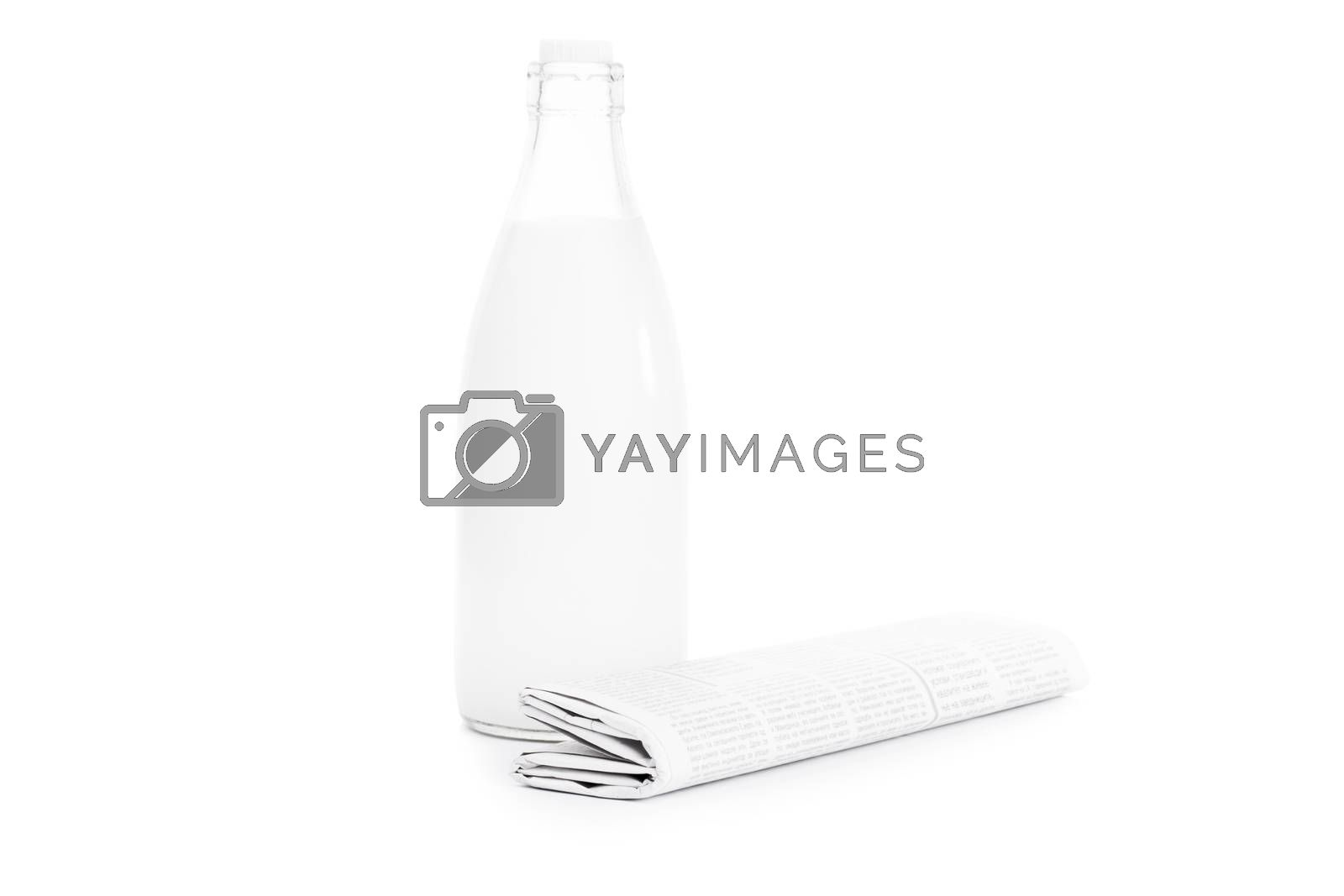 Close up shot of a rolled up newspaper and an old school bottle of milk, isolated on white background.